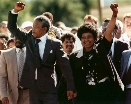 FILE - In this Feb. 11, 1990, file photo, Nelson Mandela and his wife, Winnie, raise clenched fists as they walk hand-in-hand upon his release from prison in Cape Town, South Africa. South Africa's president says, Thursday, Dec. 5, 2013, that Mandela has died. He was 95.