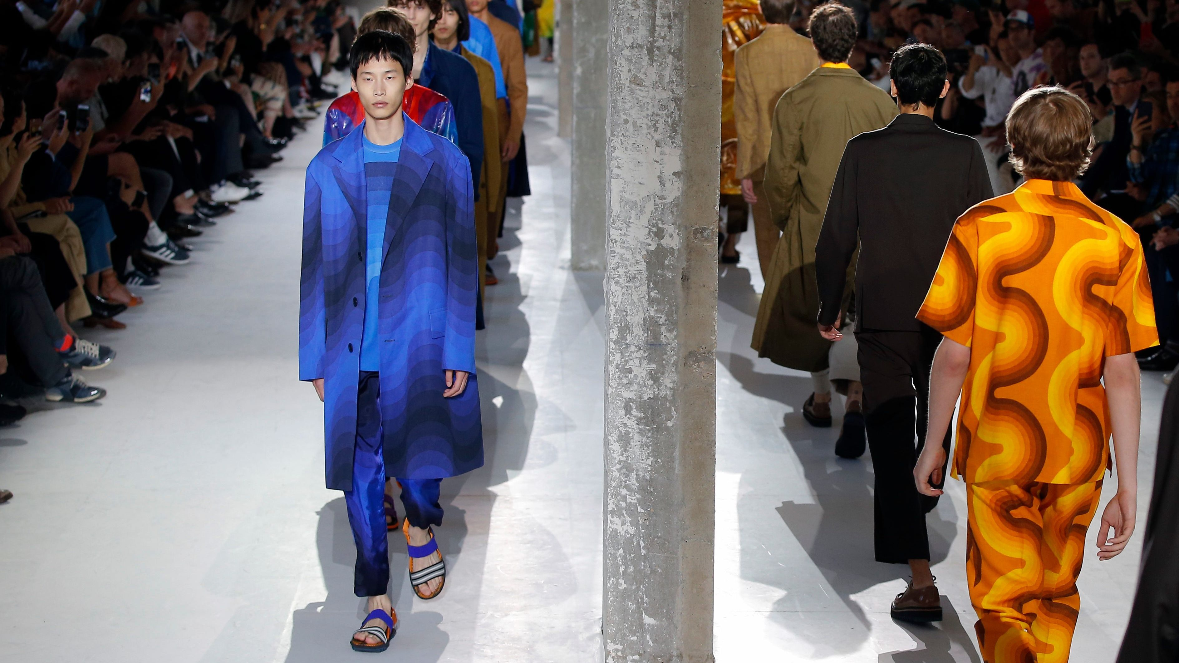 Models wear creations as part of Dries van Noten Men's Spring-Summer 2019 fashion collection presented in Paris, Thursday, June 21, 2018. (AP Photo/Michel Euler)