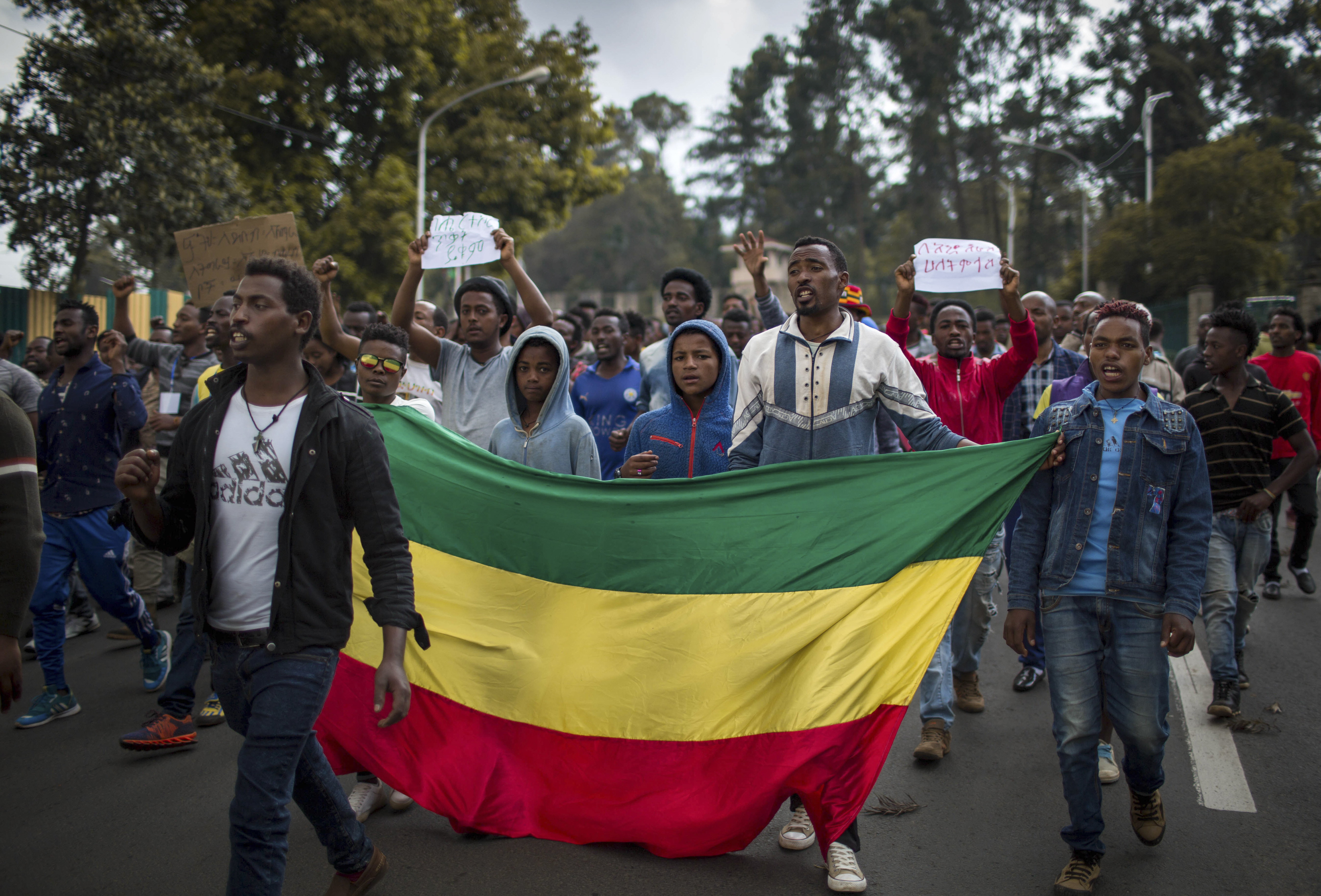 """Thousands of protestors from the capital and those displaced by ethnic-based violence over the weekend in Burayu, demonstrate to demand justice from the government in Addis Ababa, Ethiopia Monday, Sept. 17, 2018. Several thousand Ethiopians have gone out onto the streets of the capital to protest ethnic-based attacks in the outskirts of the city in which more than 20 people died over the weekend. Three banners in Amharic from left to right read """"Justice for the people of Amhara, Tigray and Southerners"""", """"Stop ethnic-based attacks"""" and """"One mouth, but two tongues""""."""
