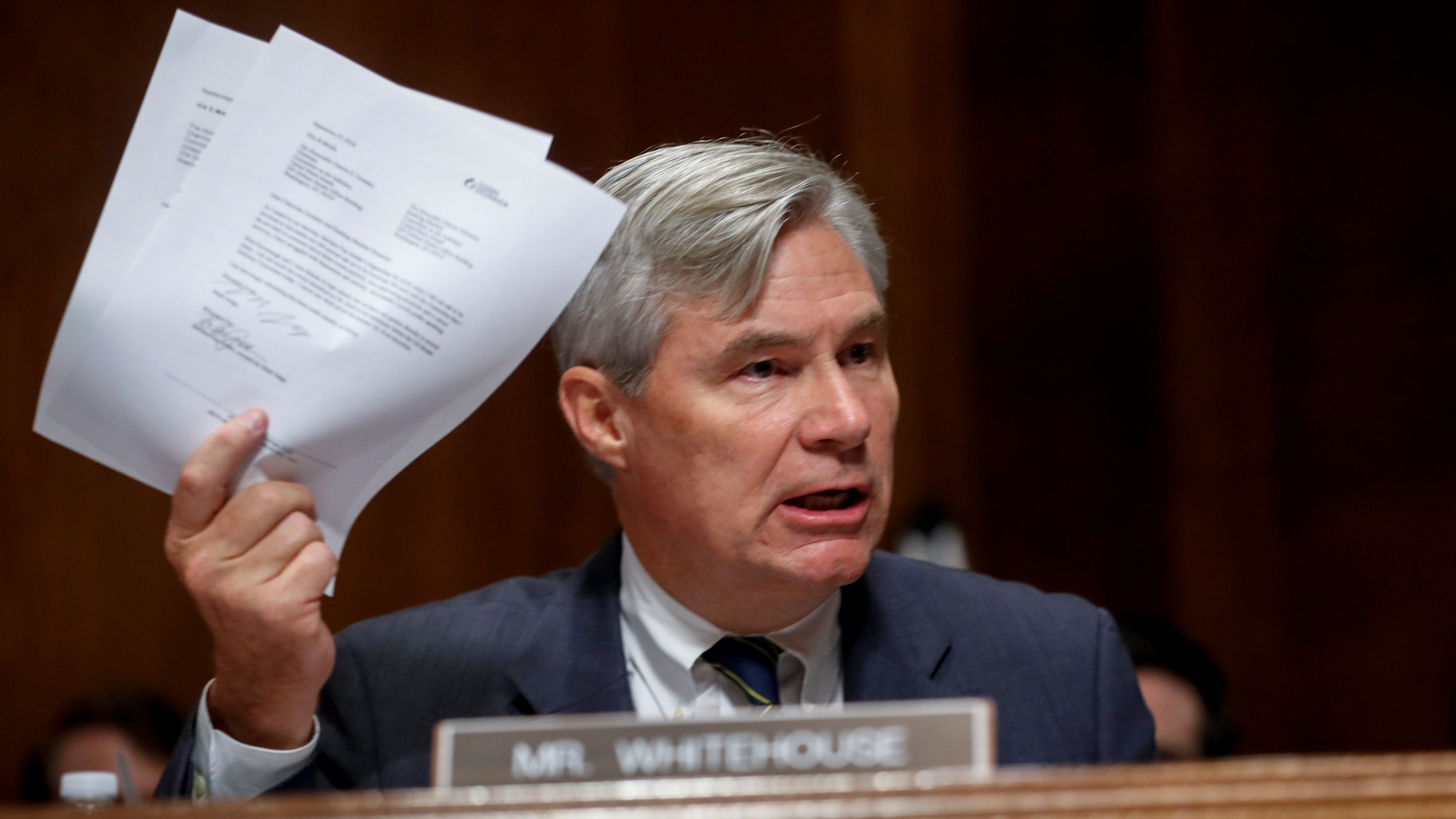 Sheldon Whitehouse brandishes documents during a Senate Judiciary Committee hearing for Brett Kavanaugh's supreme court nomination.