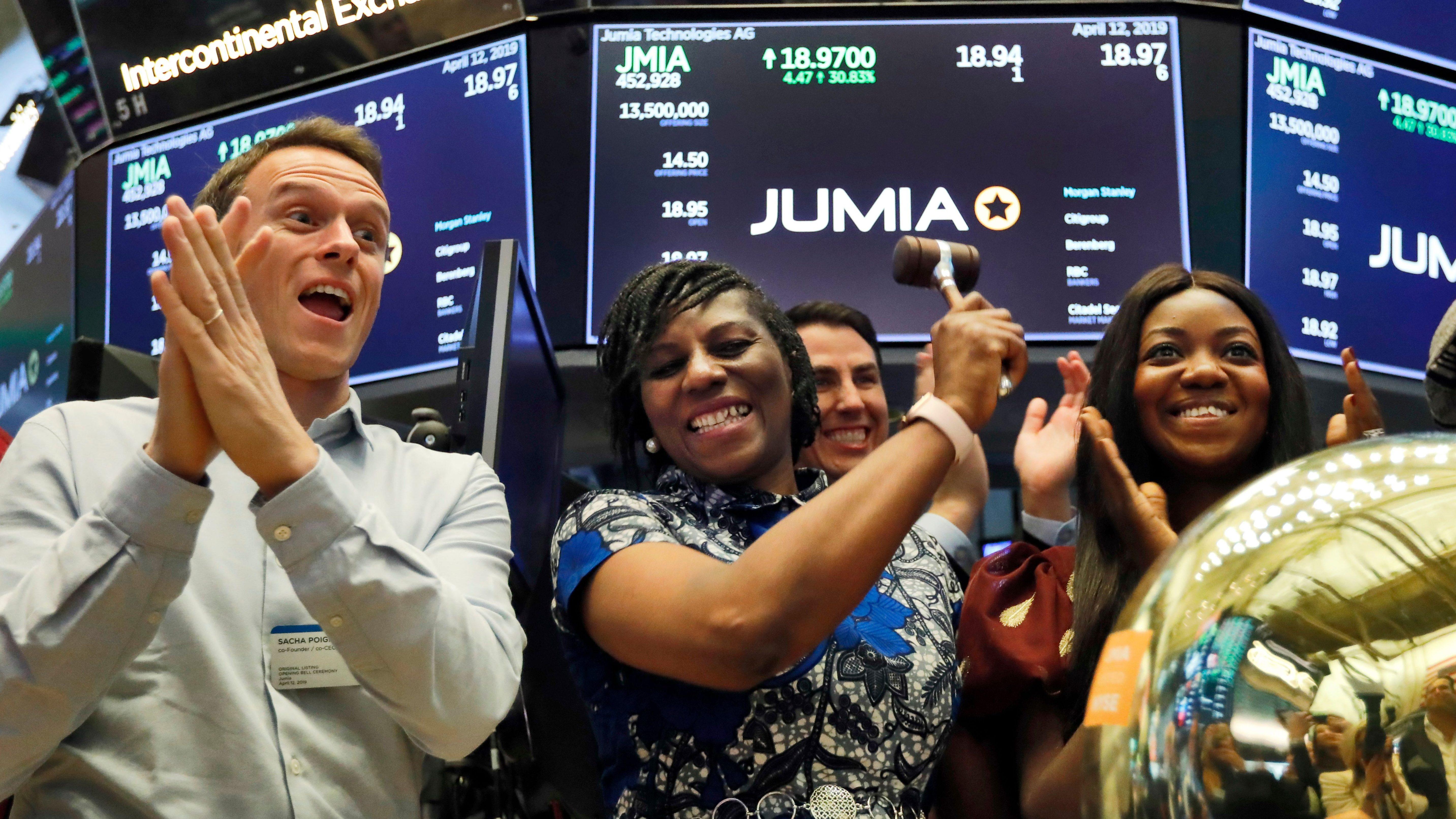 Jumia co-CEO Sacha Poignonnec applauds and Jumia Nigeria CEO Juliet Anammah