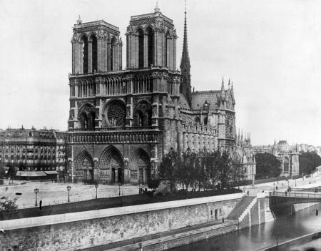 This 1911, file photo shows the Notre Dame Cathedral, on the island called Ile de la Cite in Paris. Art experts around the world reacted with horror to news of the fire that ravaged cathedral on Monday, April 15, 2019. One shell-shocked art expert is calling the beloved Gothic masterpiece 'one of the great monuments to the best of civilization.'