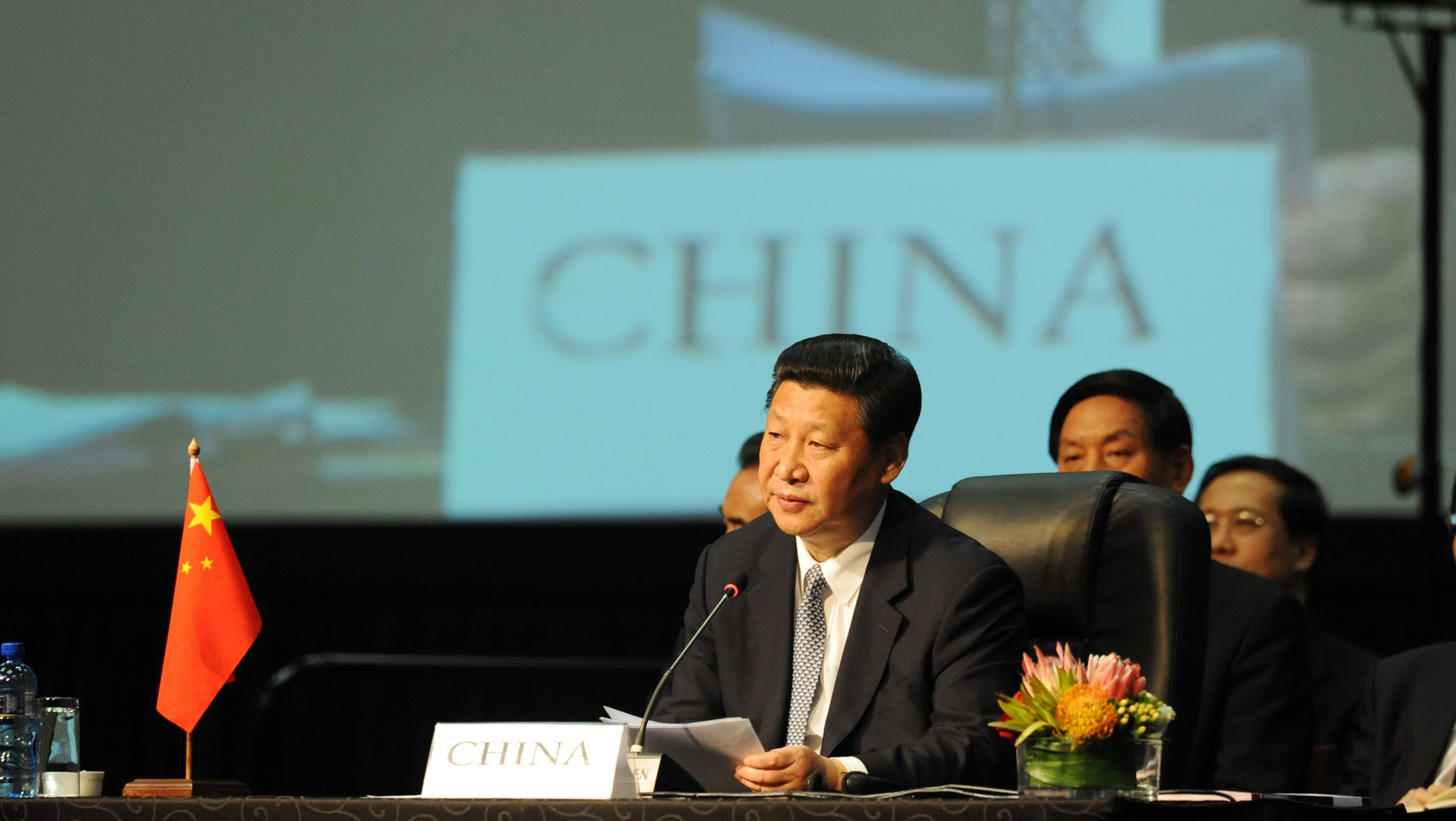 Chinese President Xi Jinping listens during the BRICS 2013 Summit in Durban, South Africa, Wednesday March 27, 2013. Heads of State of BRICS nations met in the South African city of Durban for the two-day summit.