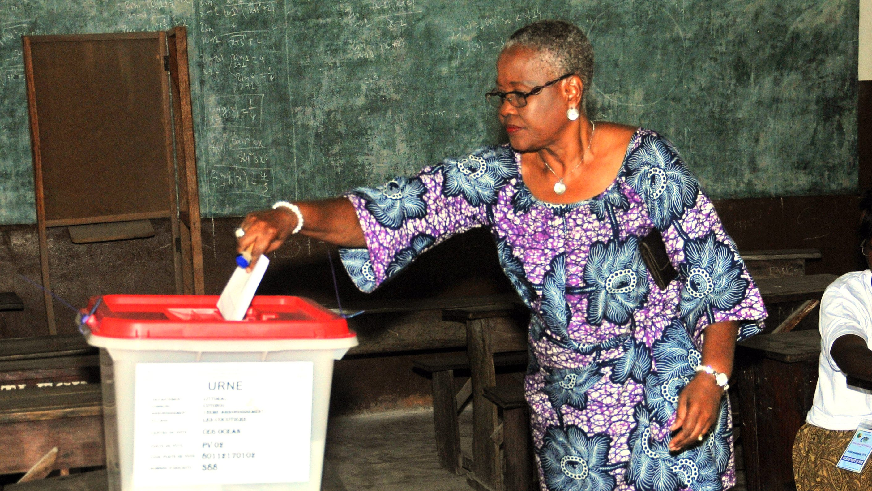 A woman cast her ballot during elections in Cotonou, Benin, Sunday, March 6, 2016. Benin citizens voted Sunday in an election to choose a successor to the West African nation's president, who is stepping down after two terms.