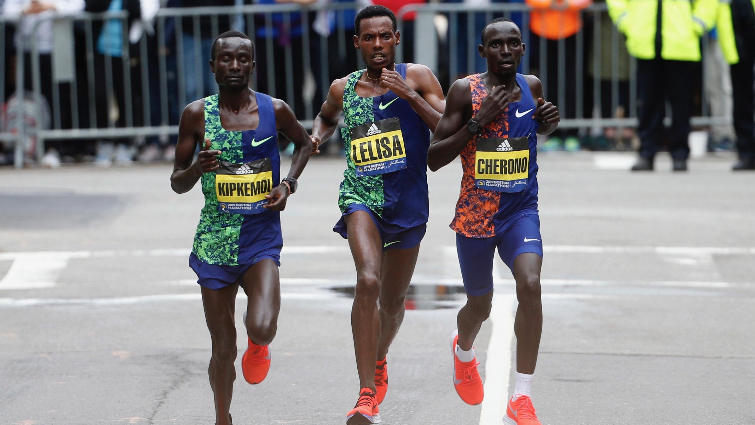 Kenneth Kipkemoi, Lawrence Cherono, and Lelisa Desisa racing to the finish during the 2019 Boston Marathon.