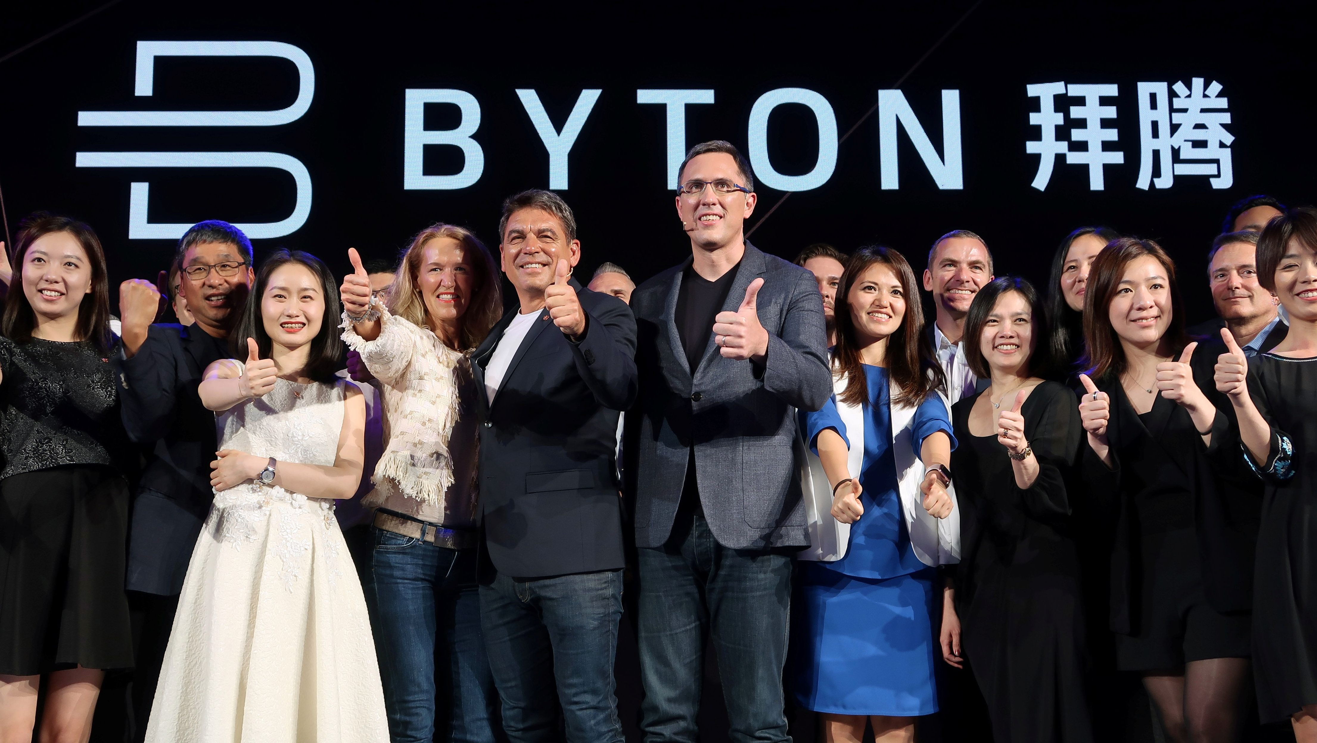 Carsten Breitfeld (centre L) and Daniel Kirchert (centre R), co-founders of electric vehicle (EV) startup Byton, attend a news conference in Beijing, China April 20, 2018.