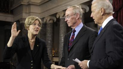 Vice President Joe Biden administers the Senate Oath to Sen. Elizabeth Warren, D-Mass., accompanied by her husband Bruce Mann, during a mock swearing in ceremony on Capitol Hill in Washington, Thursday, Jan. 3, 2013, as the 113th Congress officially began.