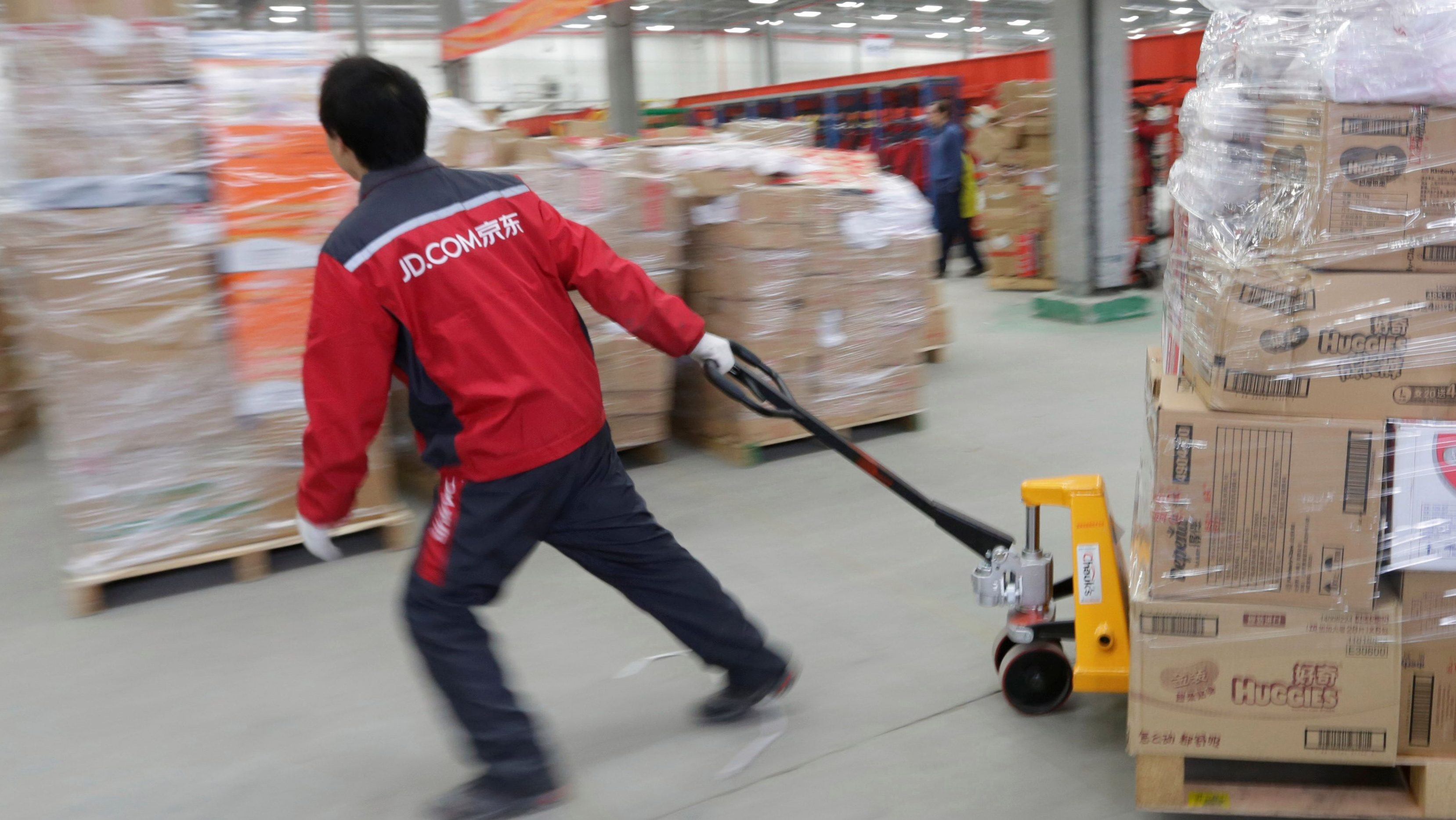 A worker moves goods at a JD.com logistics centre in Langfang, Hebei province, China November 10, 2015. Picture taken November 10, 2015.