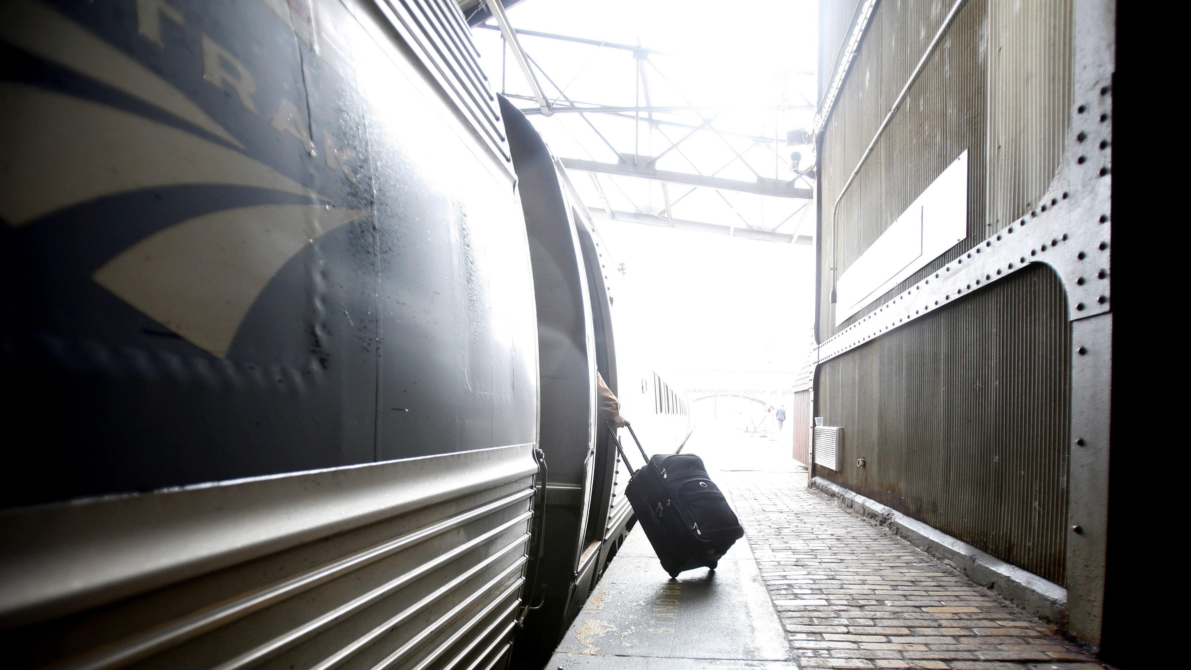 Luggage boarding a train
