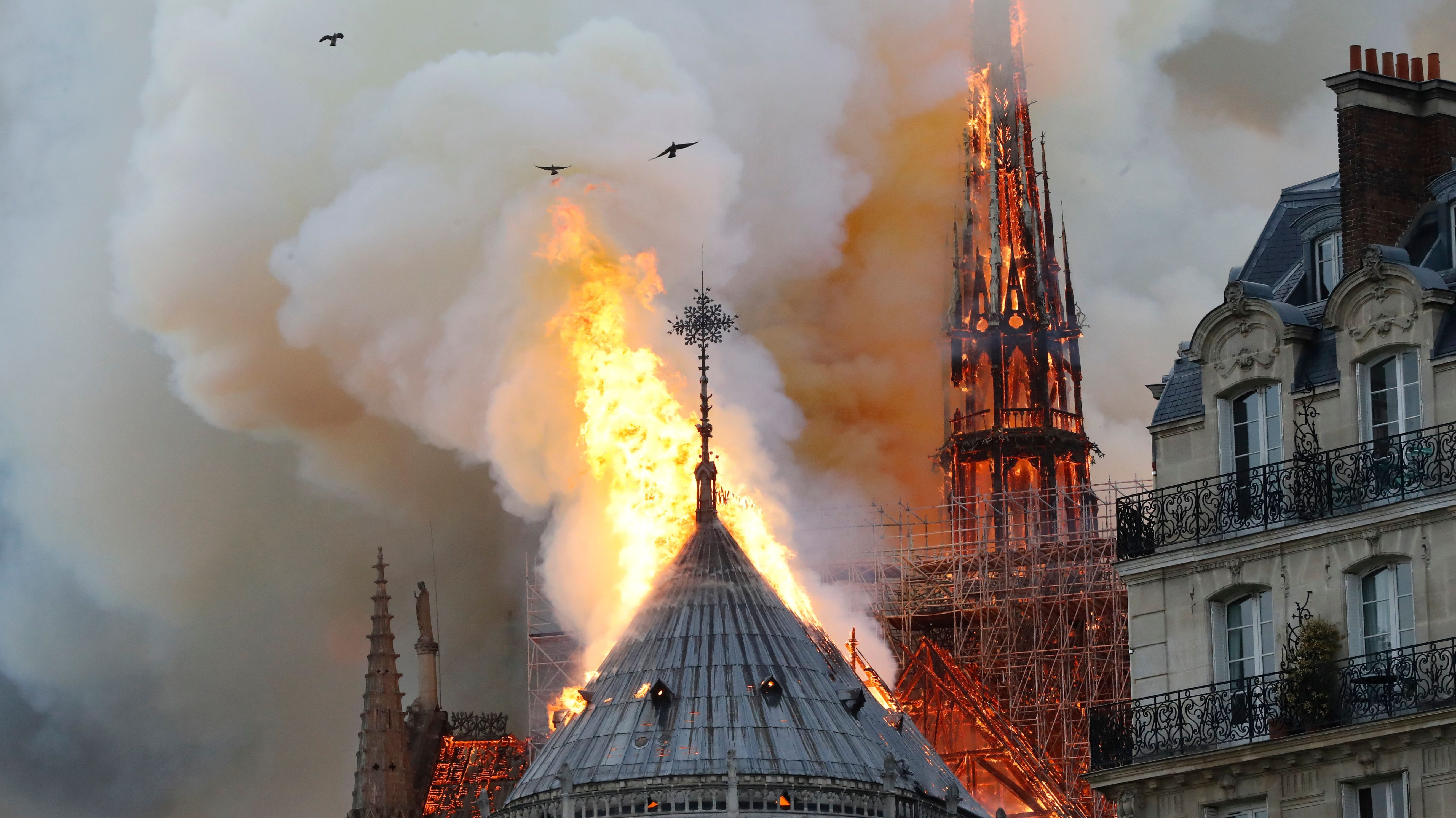 Smoke and flames rise during a fire at the landmark Notre-Dame Cathedral in central Paris on April 15, 2019