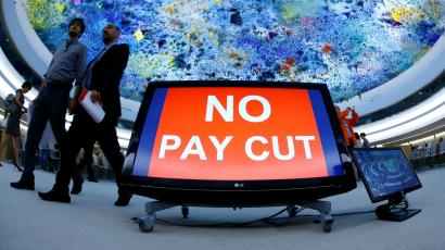 """An image of a sign that says """"no pay cut."""""""