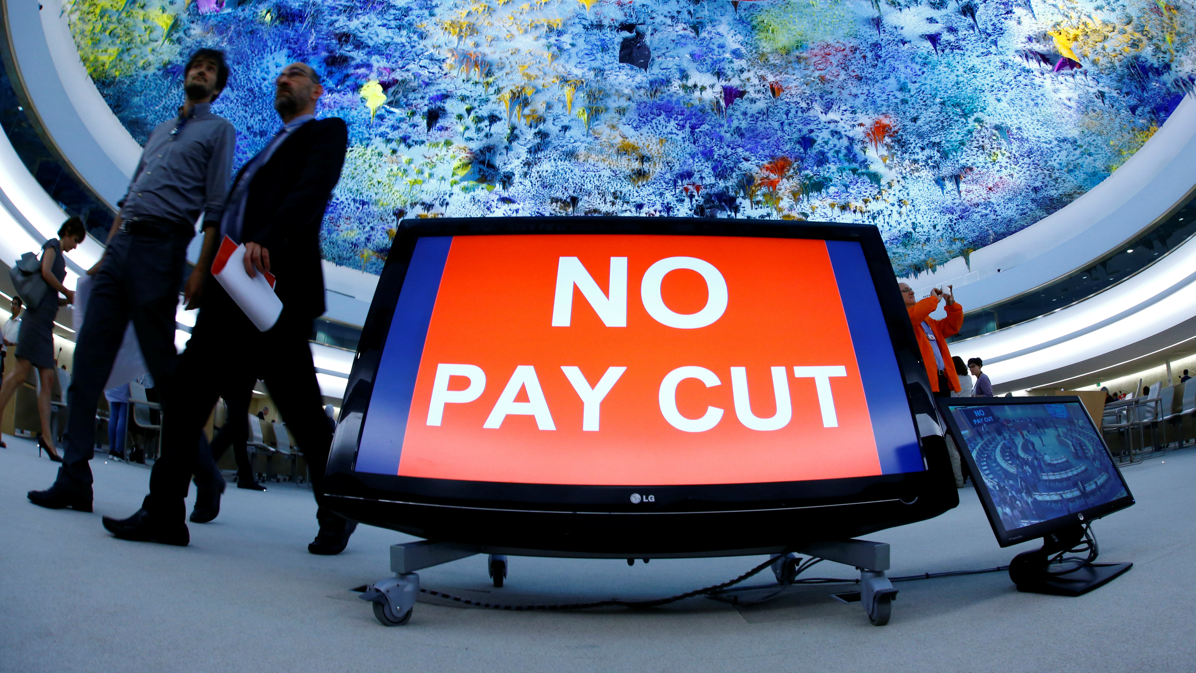 "An image of a sign that says ""no pay cut."""