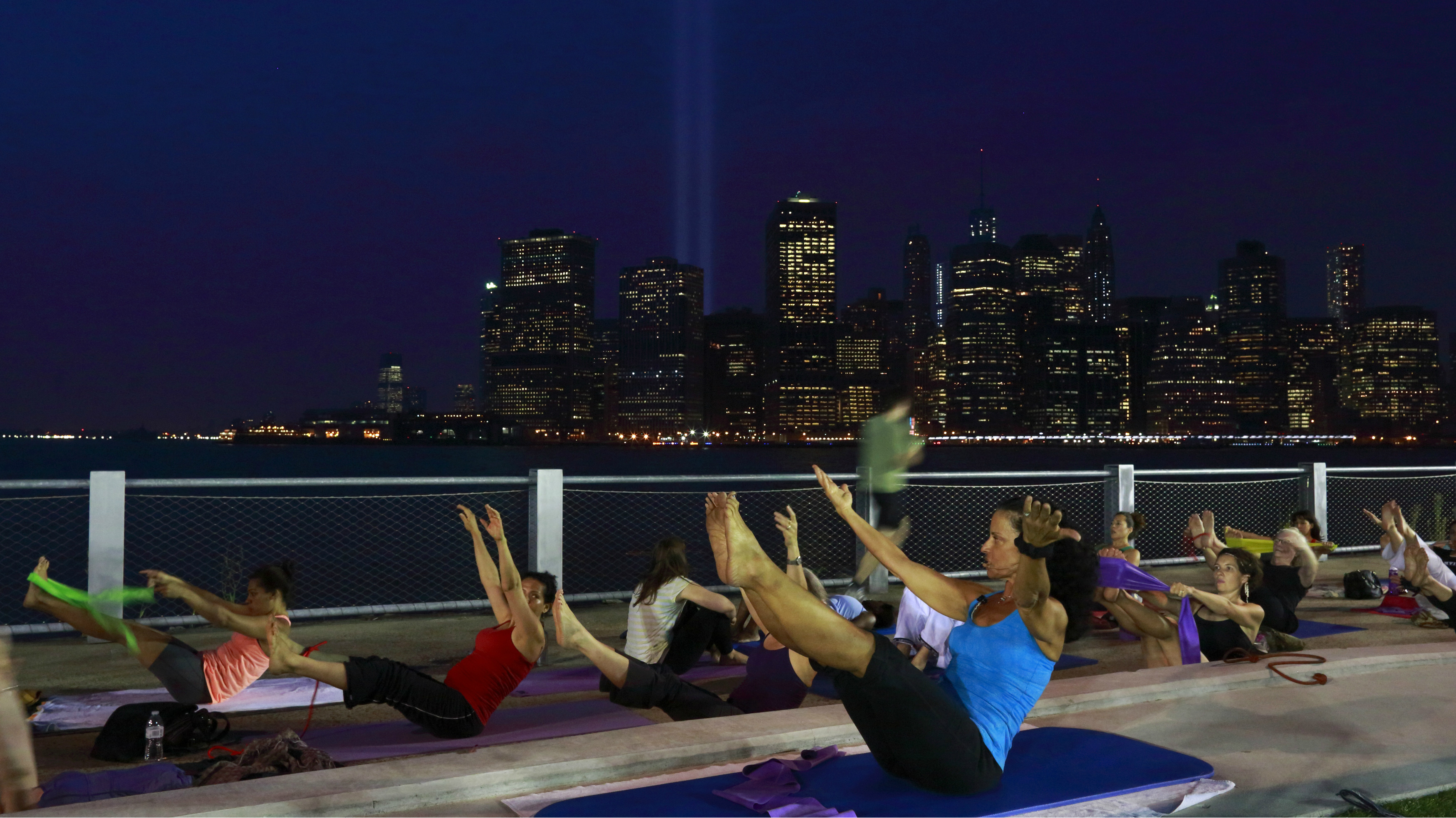 A pilates class on top of a building.