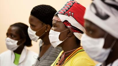 Patients with HIV and tuberculosis wear masks while awaiting consultation at a clinic in Cape Town's Khayelitsha township