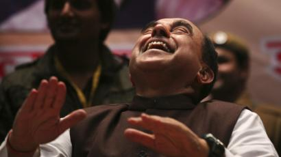 Subramanian Swamy laughs during a seminar against corruption in New Delhi