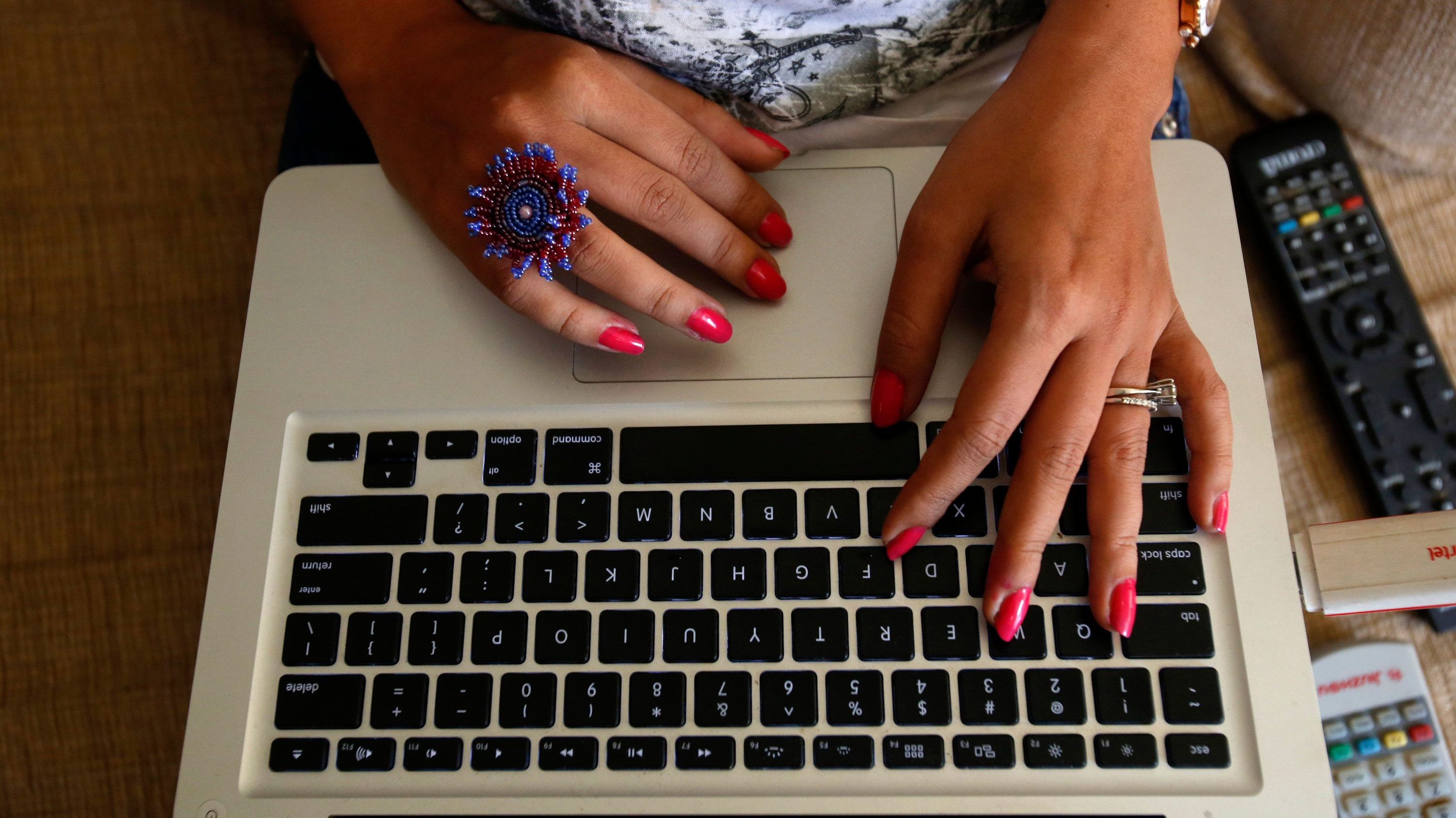 The hands of Malini Agarwal, blogger-in-chief of missmalini.com, are pictured as she blogs from her living room in Mumbai
