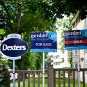 Estate agents boards are lined up outside houses in south London