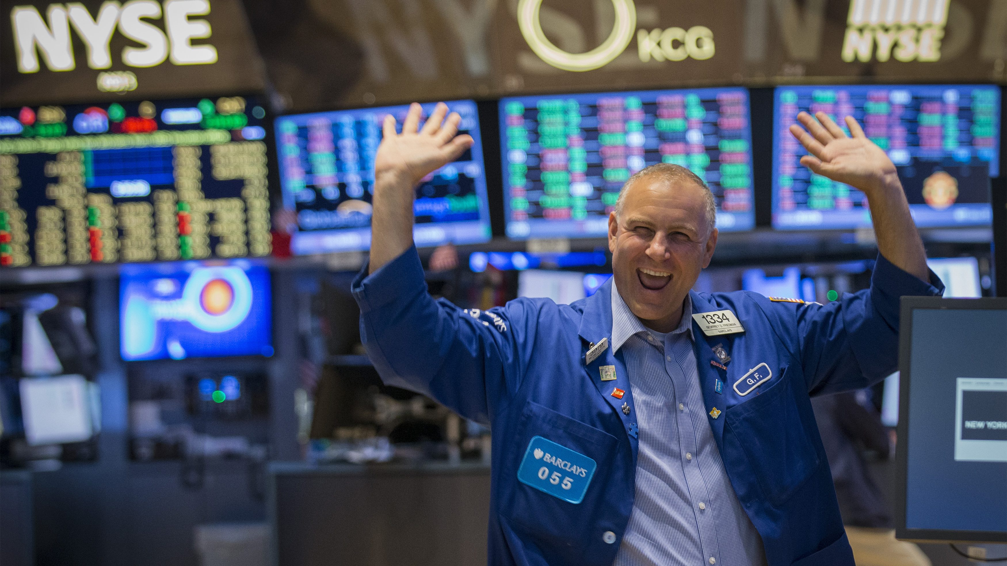 A trader reacts to the Dow Jones industrials average passing 17,000 on the floor of the New York Stock Exchange