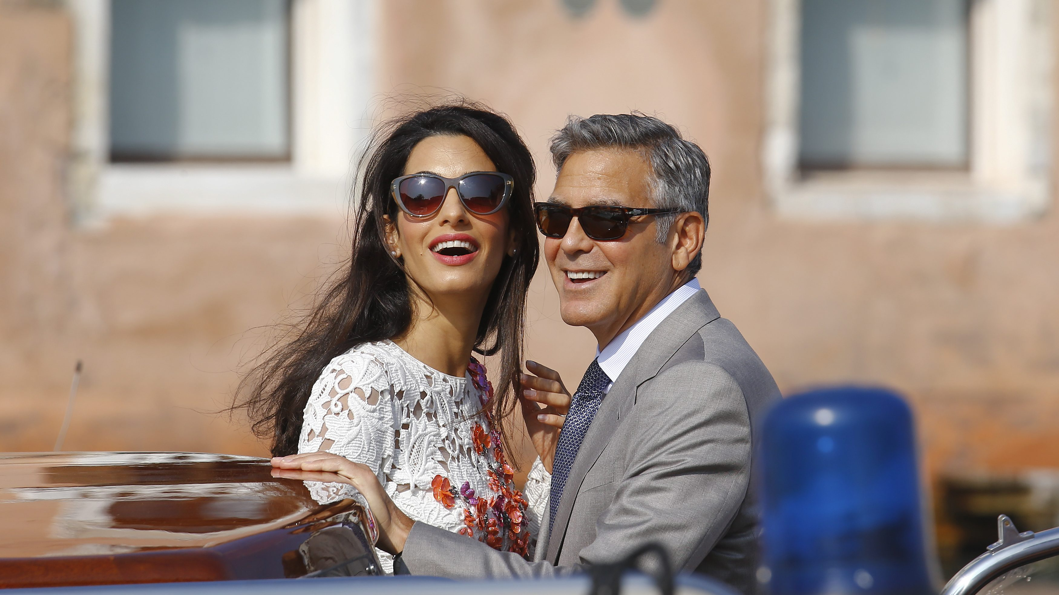 U.S. actor George Clooney and his wife Amal Alamuddin