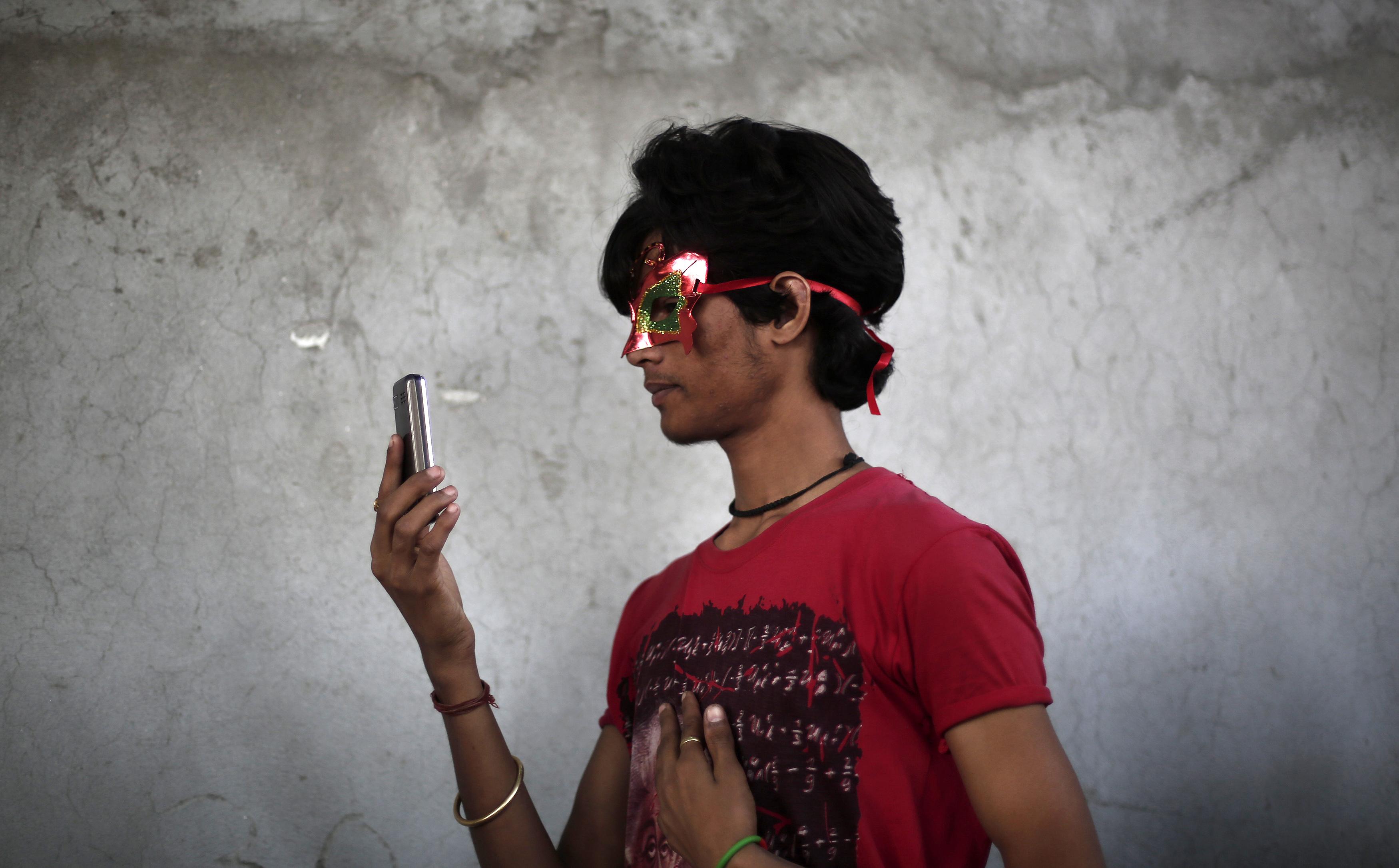 A participant takes a selfie during Delhi Queer Pride Parade in New Delhi