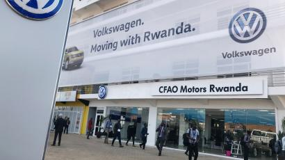 Visitors are seen outside the Volkswagen new car plant in Kigali, Rwanda June 27, 2018.