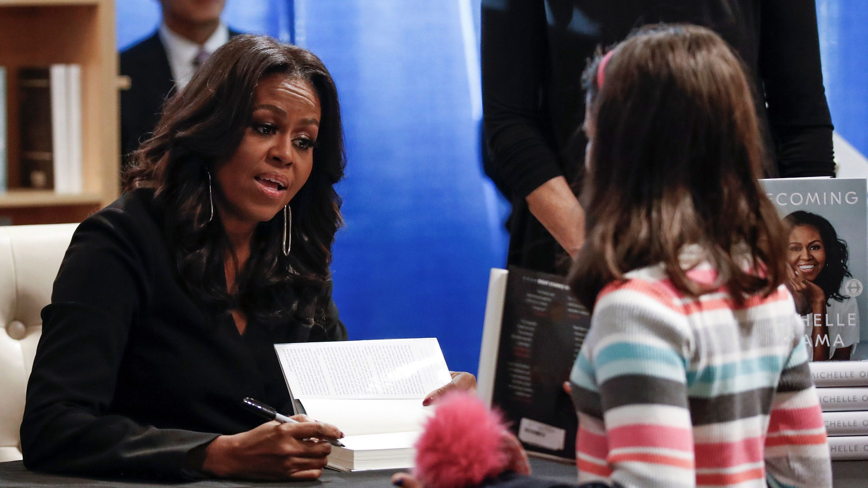 "Former first lady Michelle Obama signs copies of her memoir ""Becoming"" at the Seminary Co-op Bookstore in Chicago"