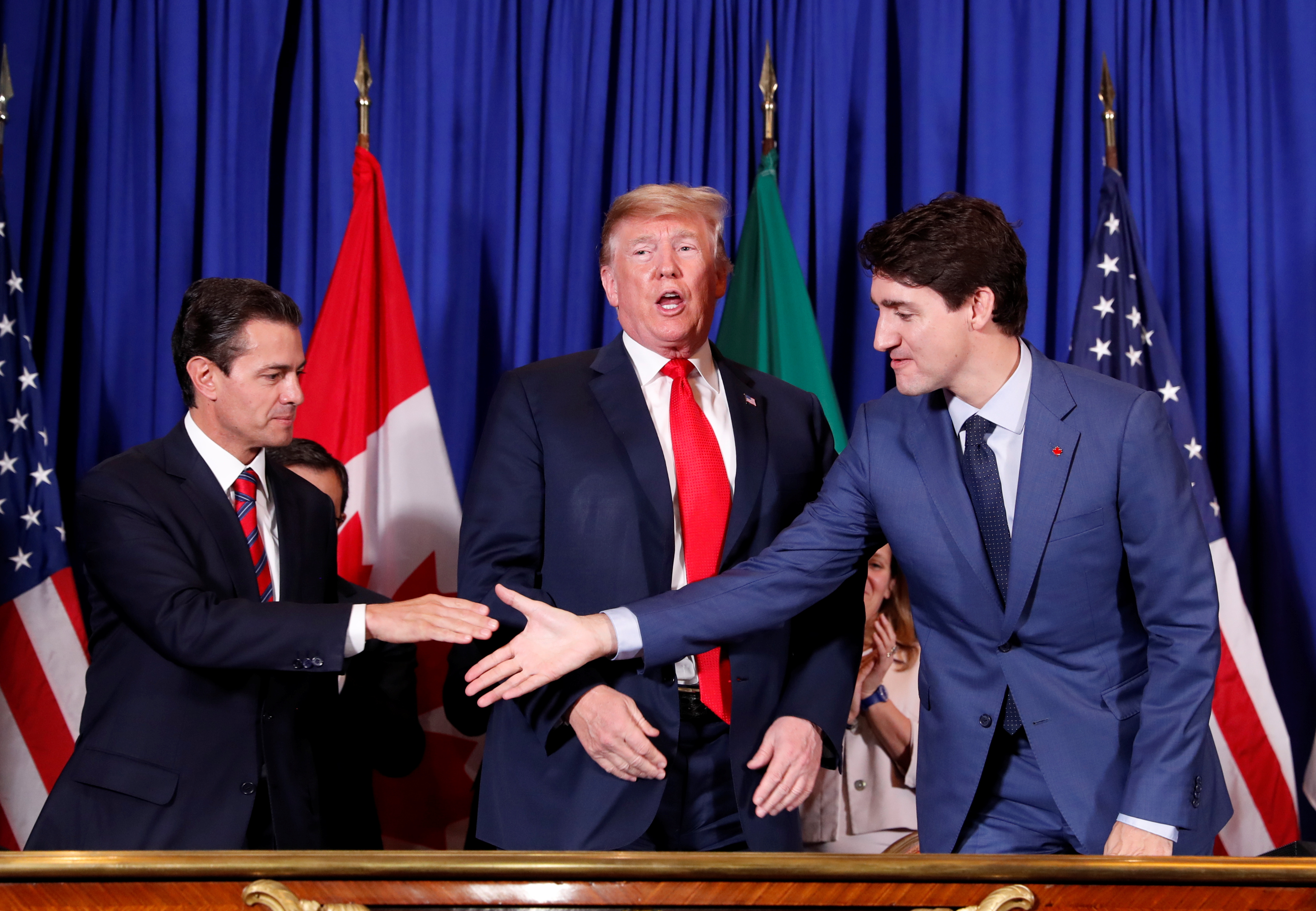 U.S. President Donald Trump, Canada's Prime Minister Justin Trudeau and Mexico's President Enrique Pena Nieto attend the USMCA signing ceremony before the G20 leaders summit in Buenos Aires, Argentina November 30, 2018. REUTERS/Kevin Lamarque - RC16F417B0A0