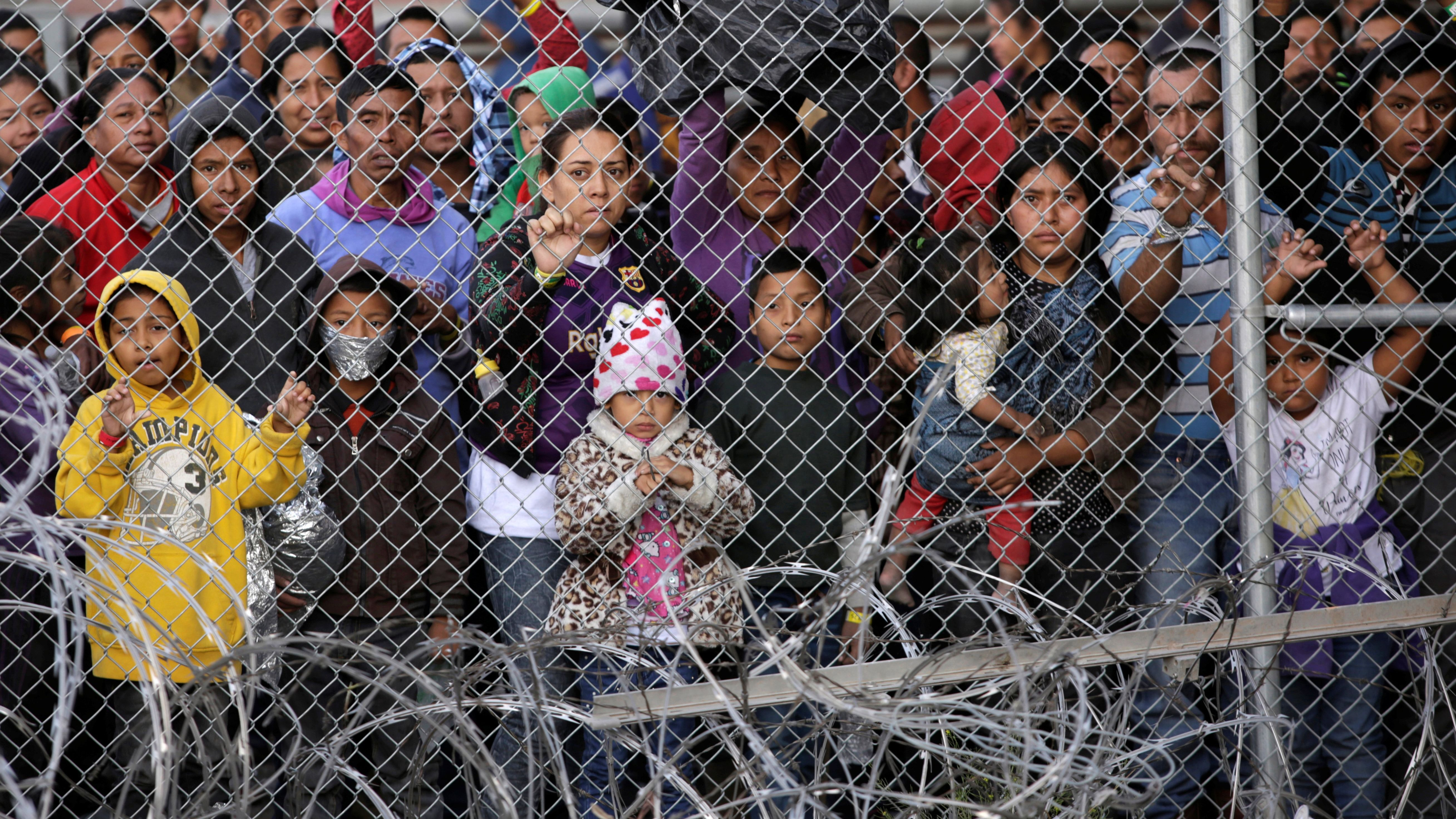 Central American migrants are seen inside an enclosure where they are being held by U.S. Customs and Border Protection (CBP), after crossing the border between Mexico and the United States illegaly and turning themselves in to request asylum, in El Paso, Texas, U.S.
