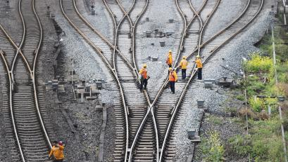 Workers inspect railway tracks, which serve as a part of the Belt and Road freight rail route linking Chongqing to Duisburg, at the Dazhou railway station