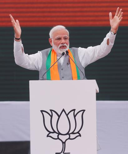 Indian Prime Minister Narendra Modi gestures as he speaks after releasing BJP's election manifesto for the April/May general election, in New Delhi