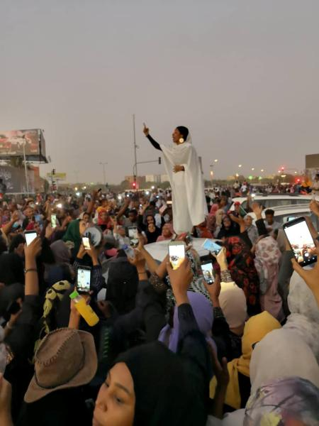 A Sudanese woman gestures during a protest demanding Sudanese President Omar Al-Bashir to step down along a bridge in Khartoum, Sudan April 8, 2019, in this still image taken from a social media video obtained on April 9, 2019.