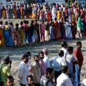 Voters line up to cast their votes outside a polling station during the first phase of general election in Alipurduar district in the eastern state of West Bengal
