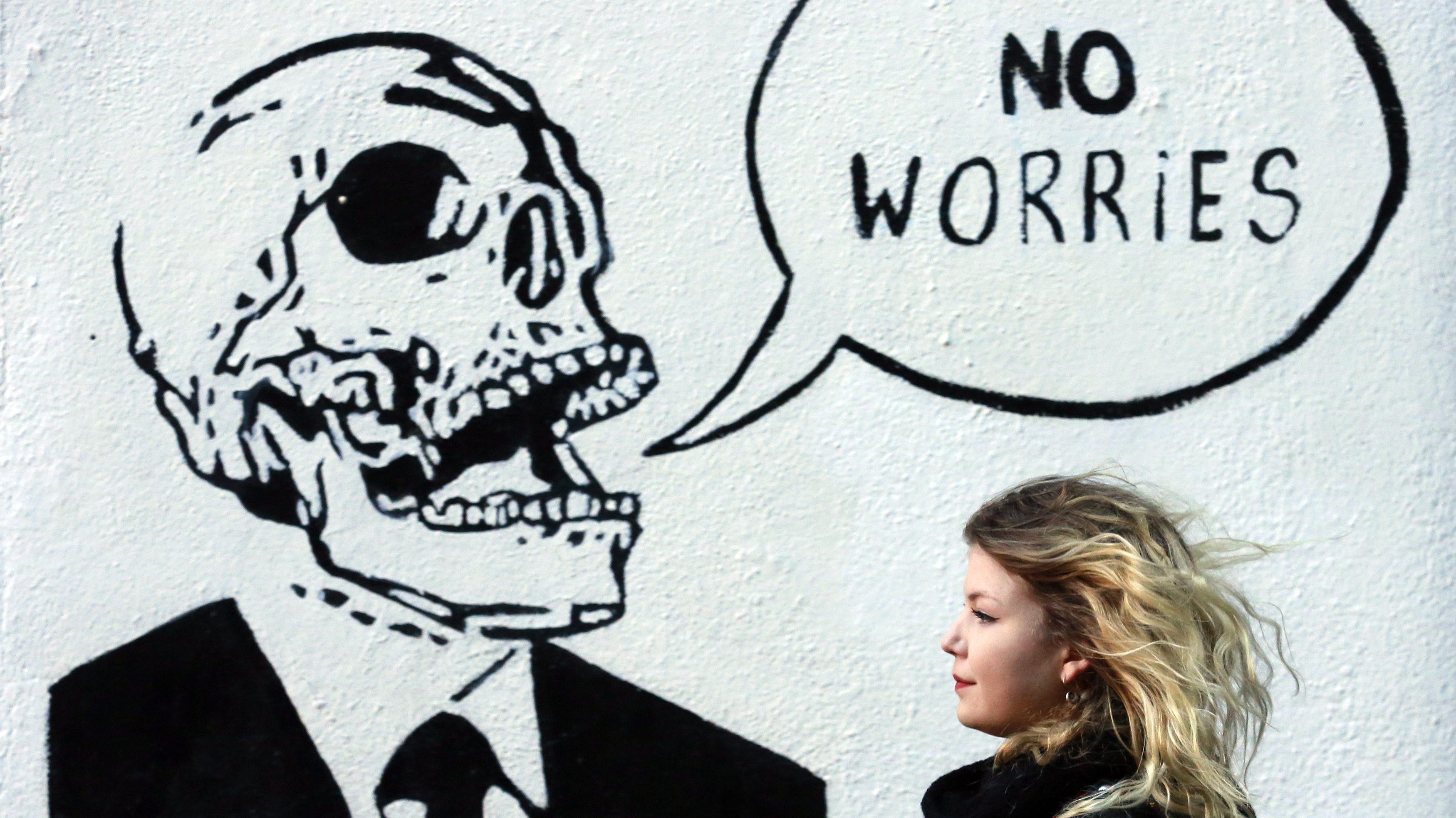 A woman walks past graffiti in the Temple Bar area of Dublin