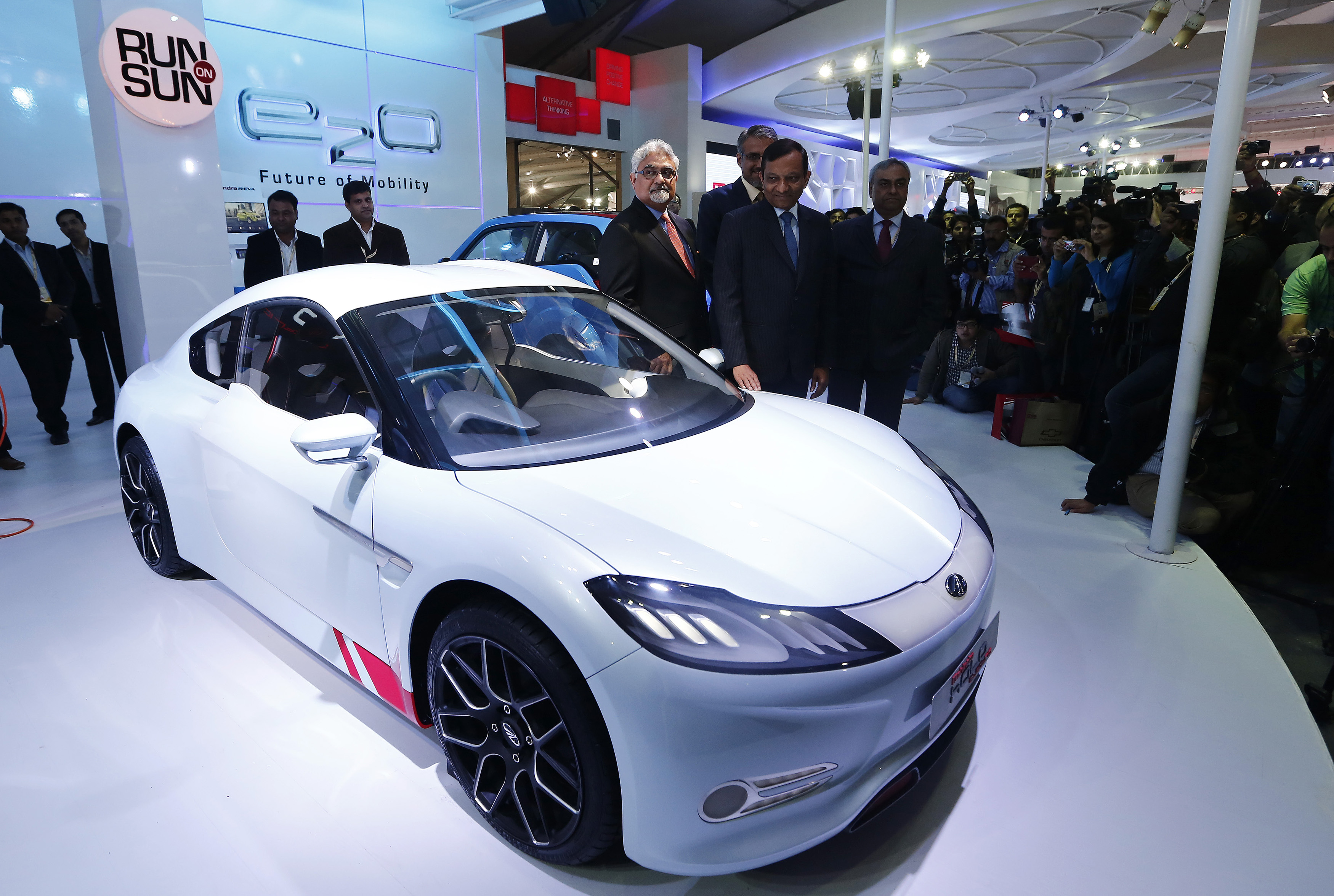 awan Goenka, president of Mahindra's automotive and farm equipment sectors, stands next to Mahindra's concept electric sports car 'Halo' after its unveiling during the Indian Auto Expo in Greater Noida,