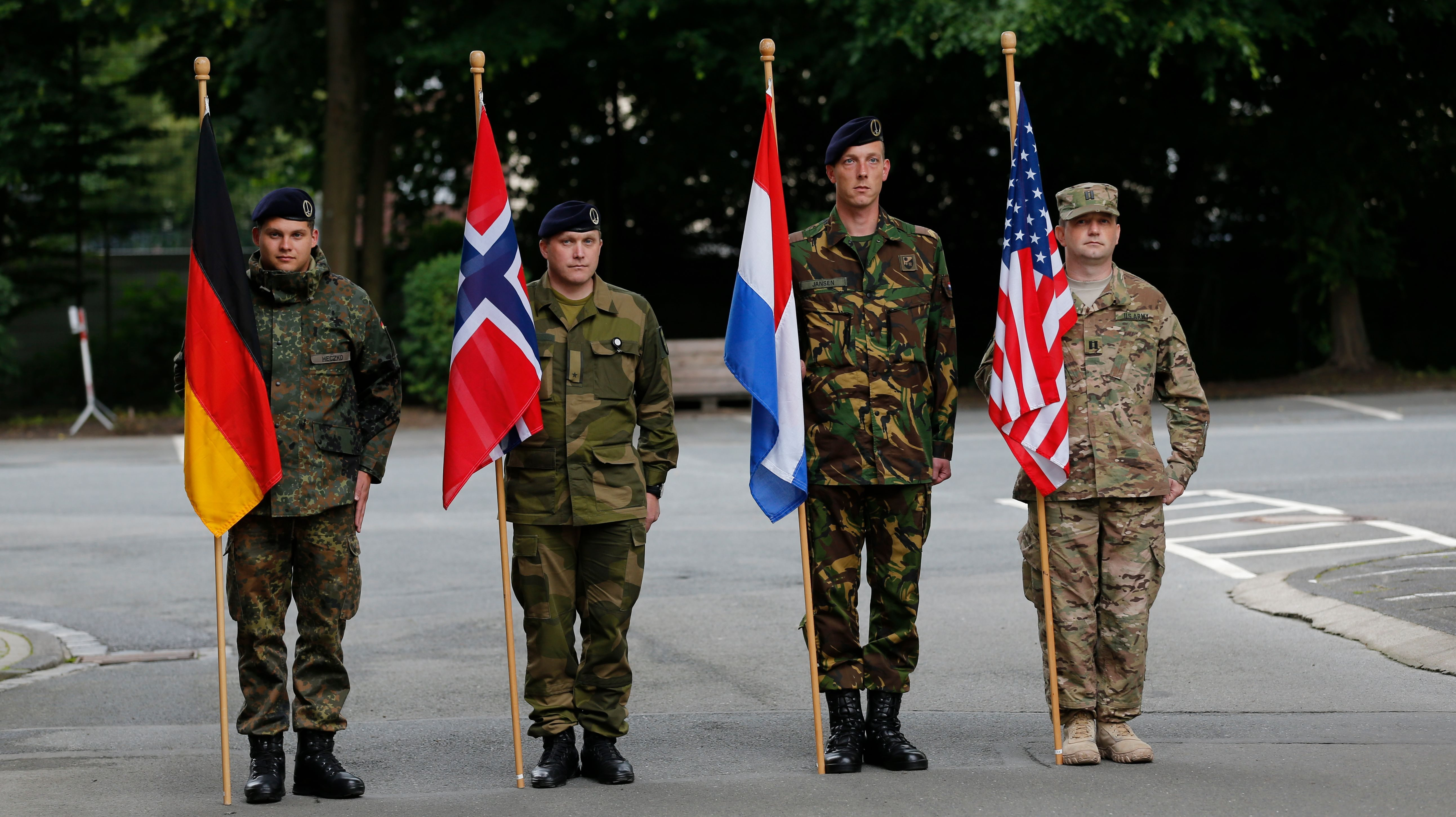 NATO states soldiers of Germany, Norway, the Netherlands and the U.S. stand to attention.