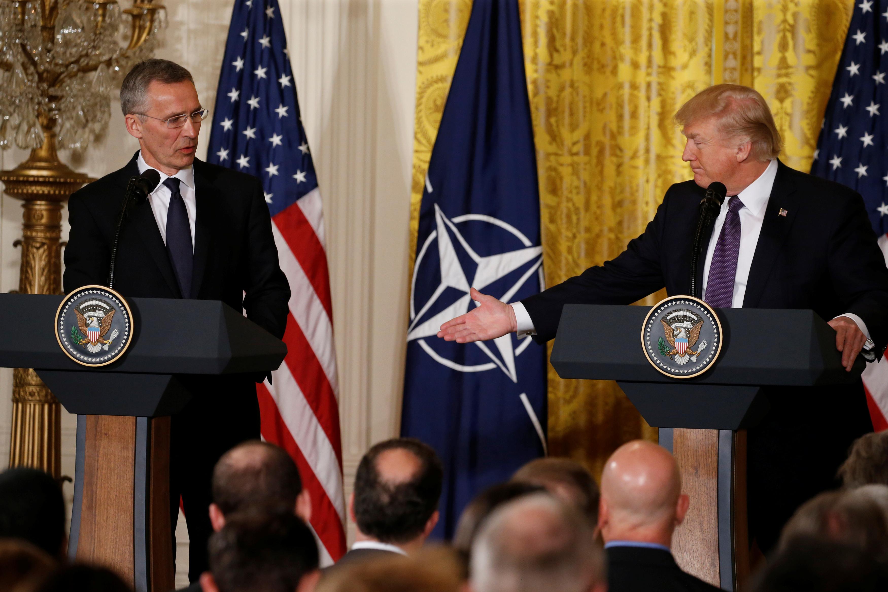 U.S. President Donald Trump (R) and NATO Secretary General Jens Stoltenberg
