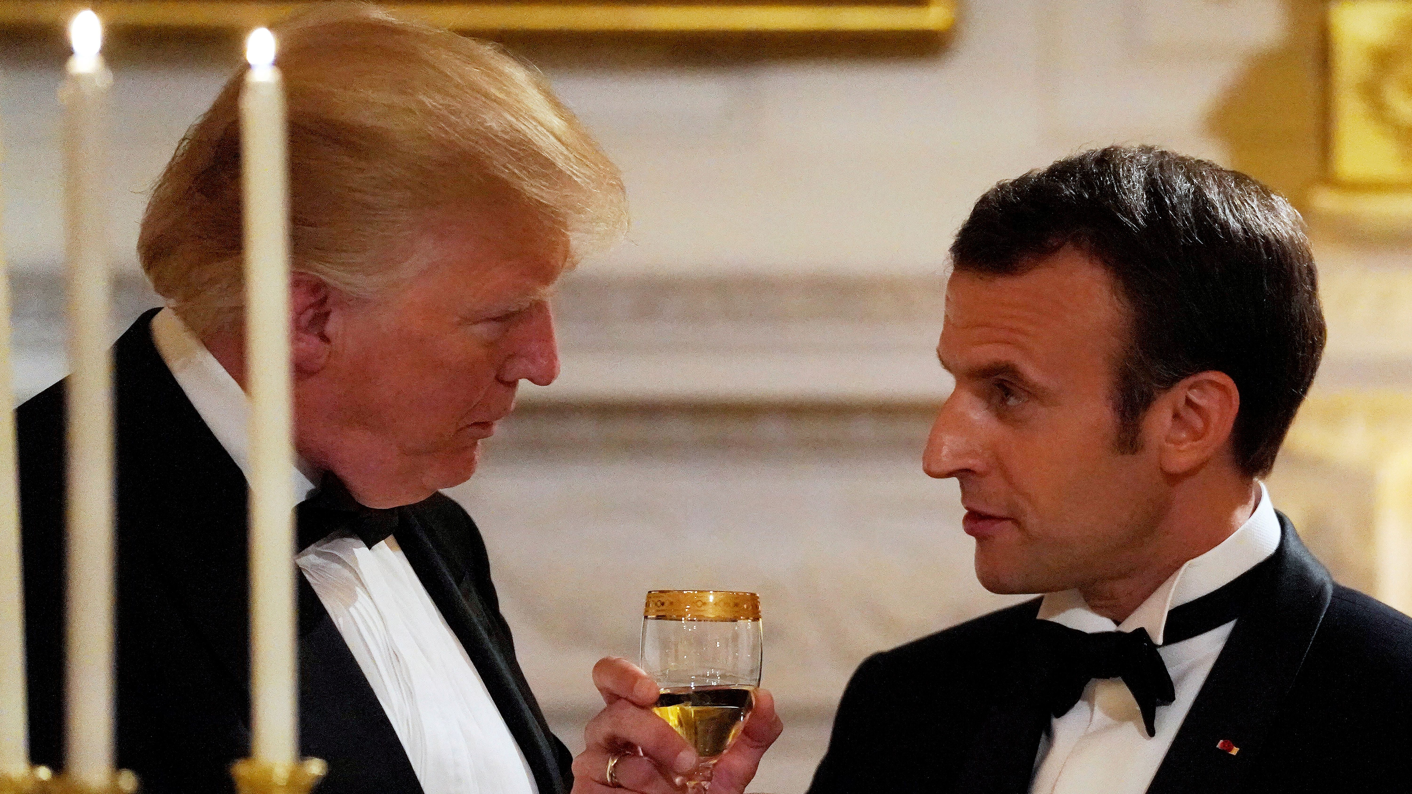 French President Emmanuel Macron toasts U.S. President Donald Trump during a State Dinner at the White House