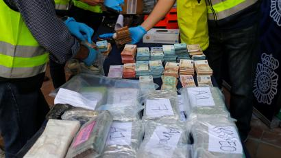 Police display a portion of the six tonnes of cocaine, money and other material seized at an industrial estate at the police headquarters in Malaga