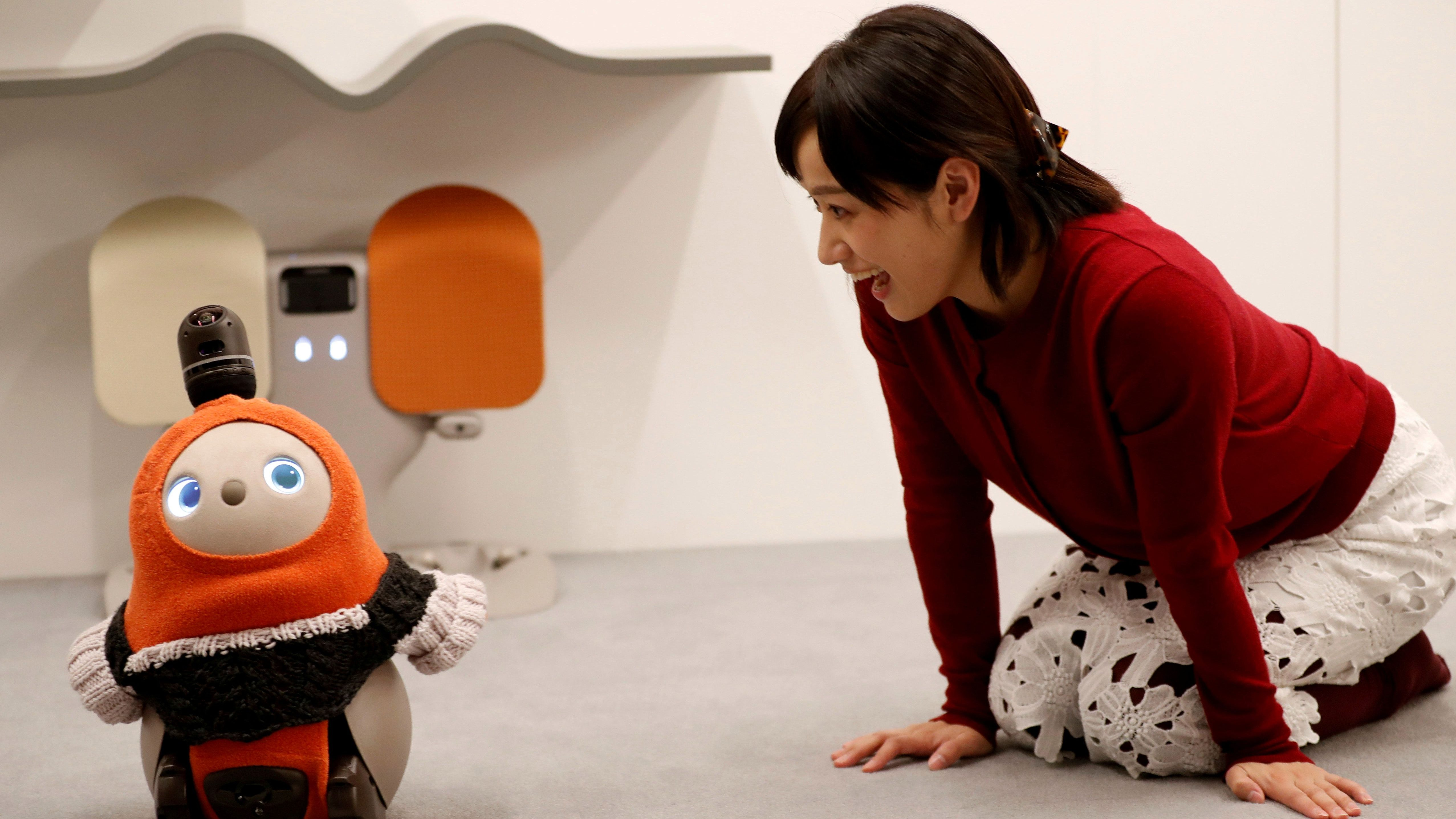 A woman with a robot
