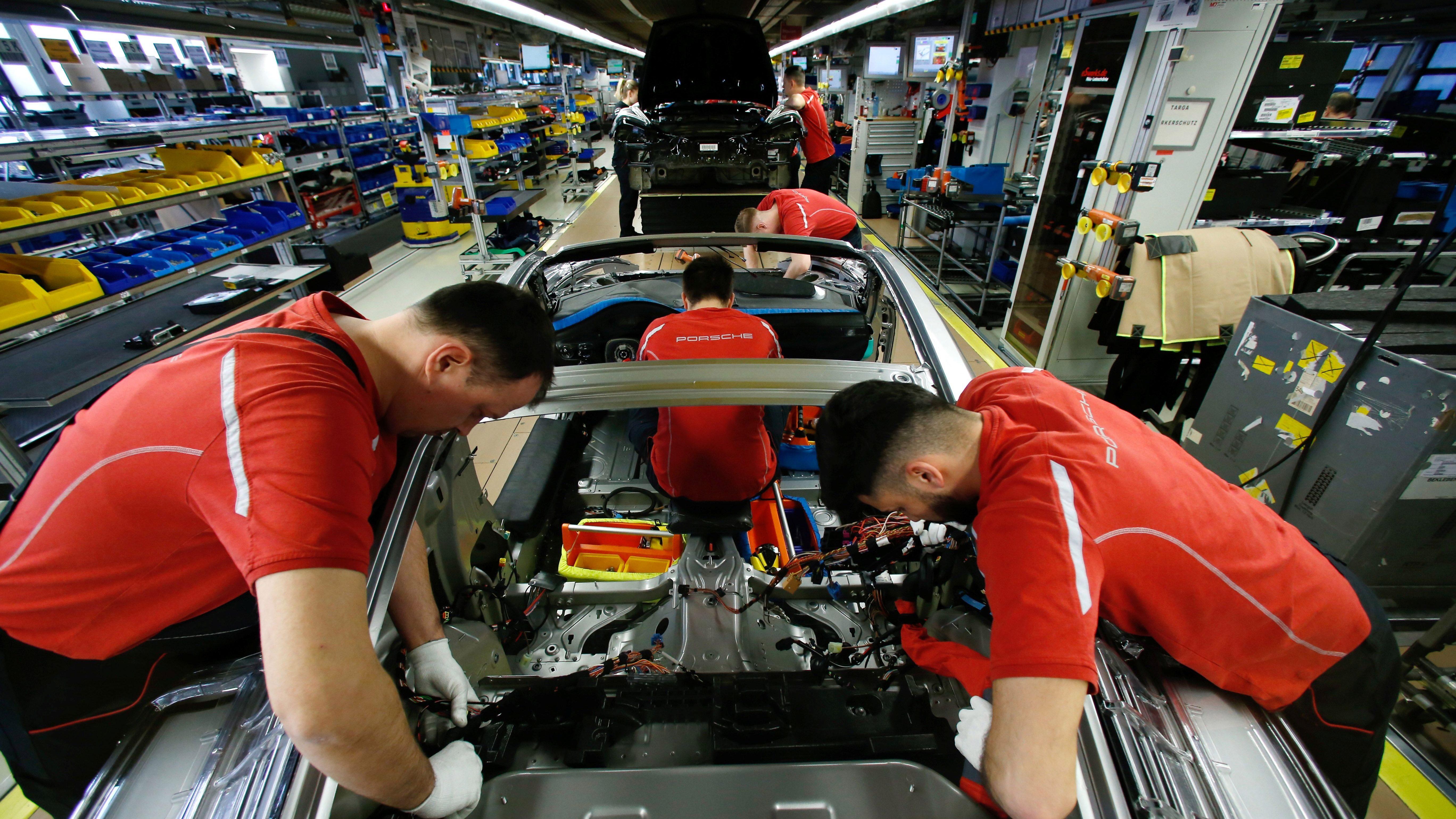 Employees of German car manufacturer Porsche