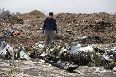 FILE PHOTO: American civil aviation and Boeing investigators search through the debris at the scene of the Ethiopian Airlines Flight ET 302 plane crash, near the town of Bishoftu, southeast of Addis Ababa, Ethiopia March 12, 2019.