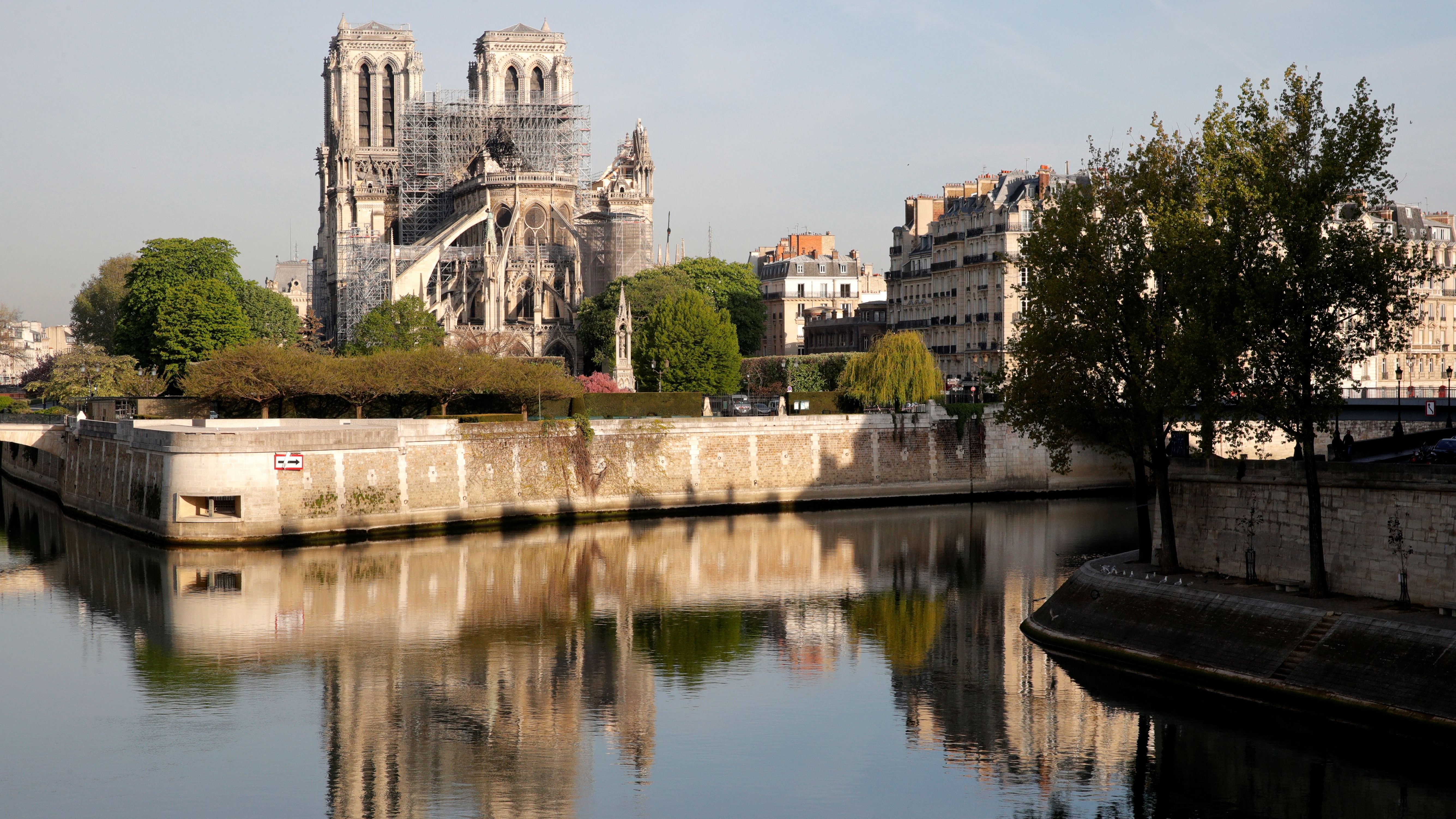 A view shows Notre-Dame Cathedral reflected on the River Seine after a massive fire devastated large parts of the gothic structure in Paris