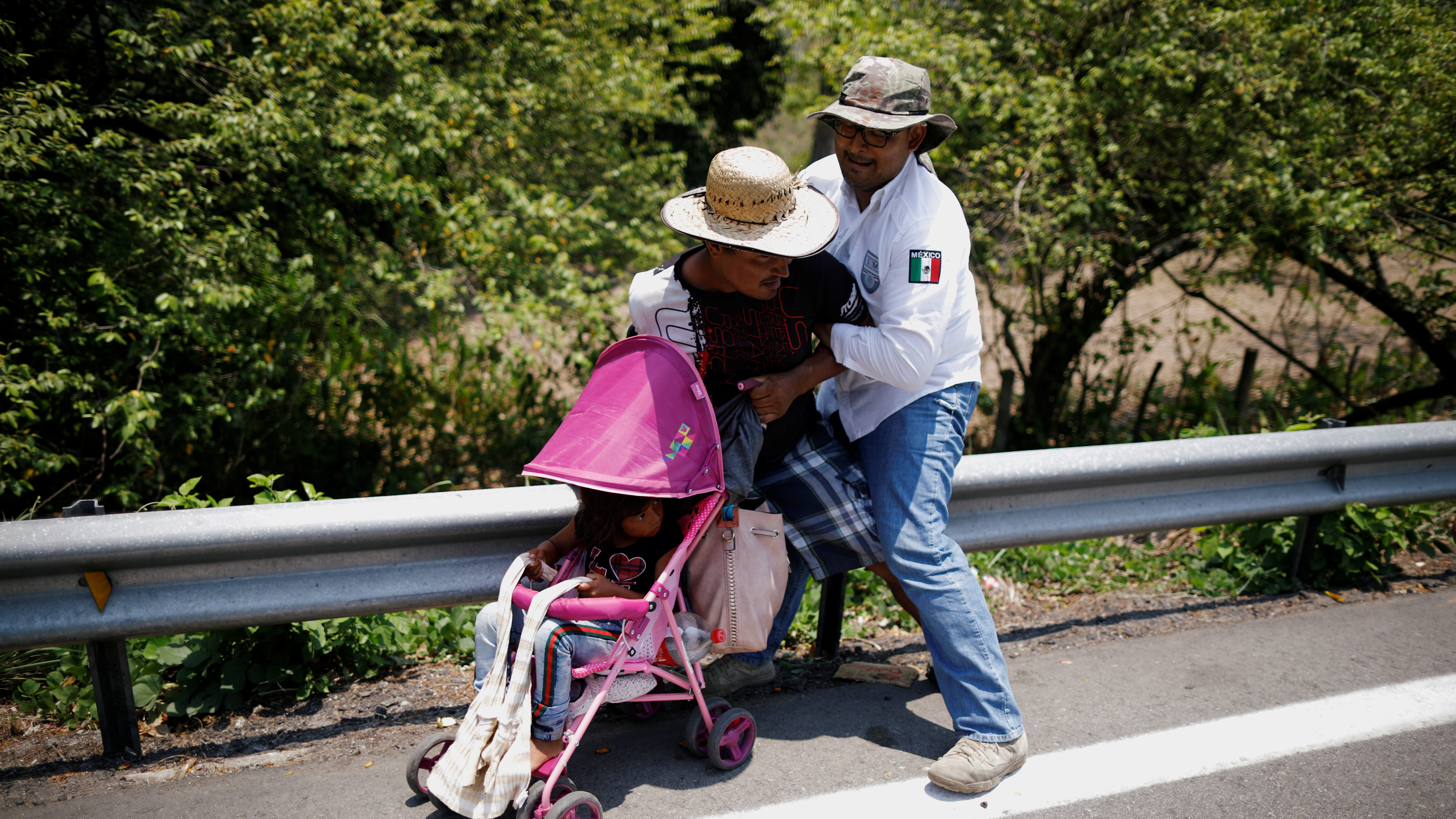 A Central American migrant is detained by an Immigration officer during a raid on their journey towards the United States, in Pijijiapan, Mexico April 22, 2019.