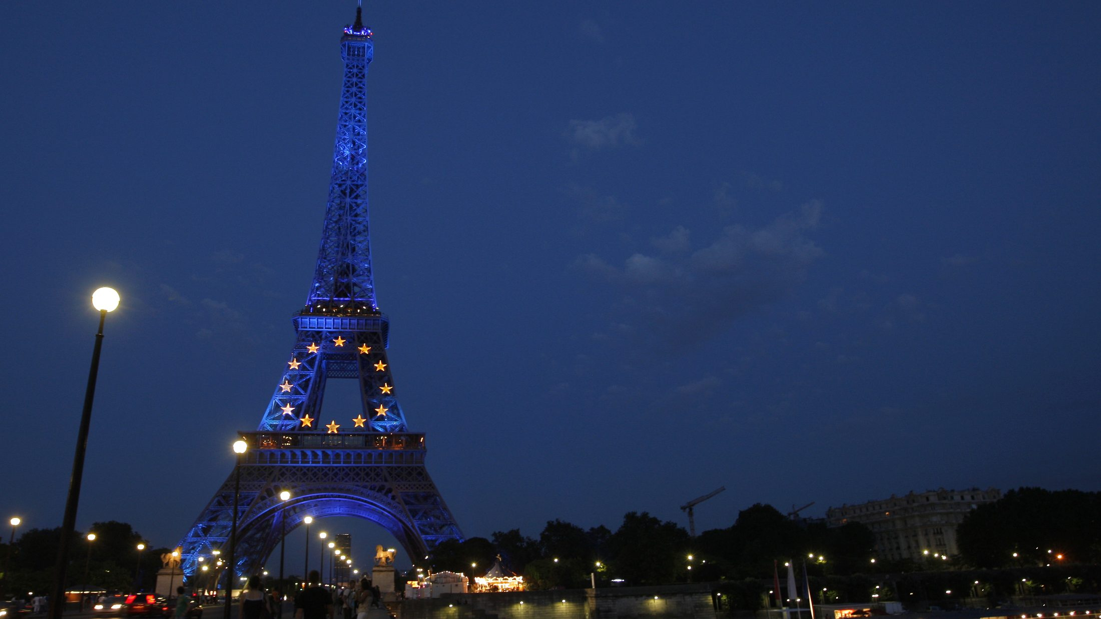 The Eiffel Tower in Paris is lighted up as France marks the start of its six-month presidency of the European Union
