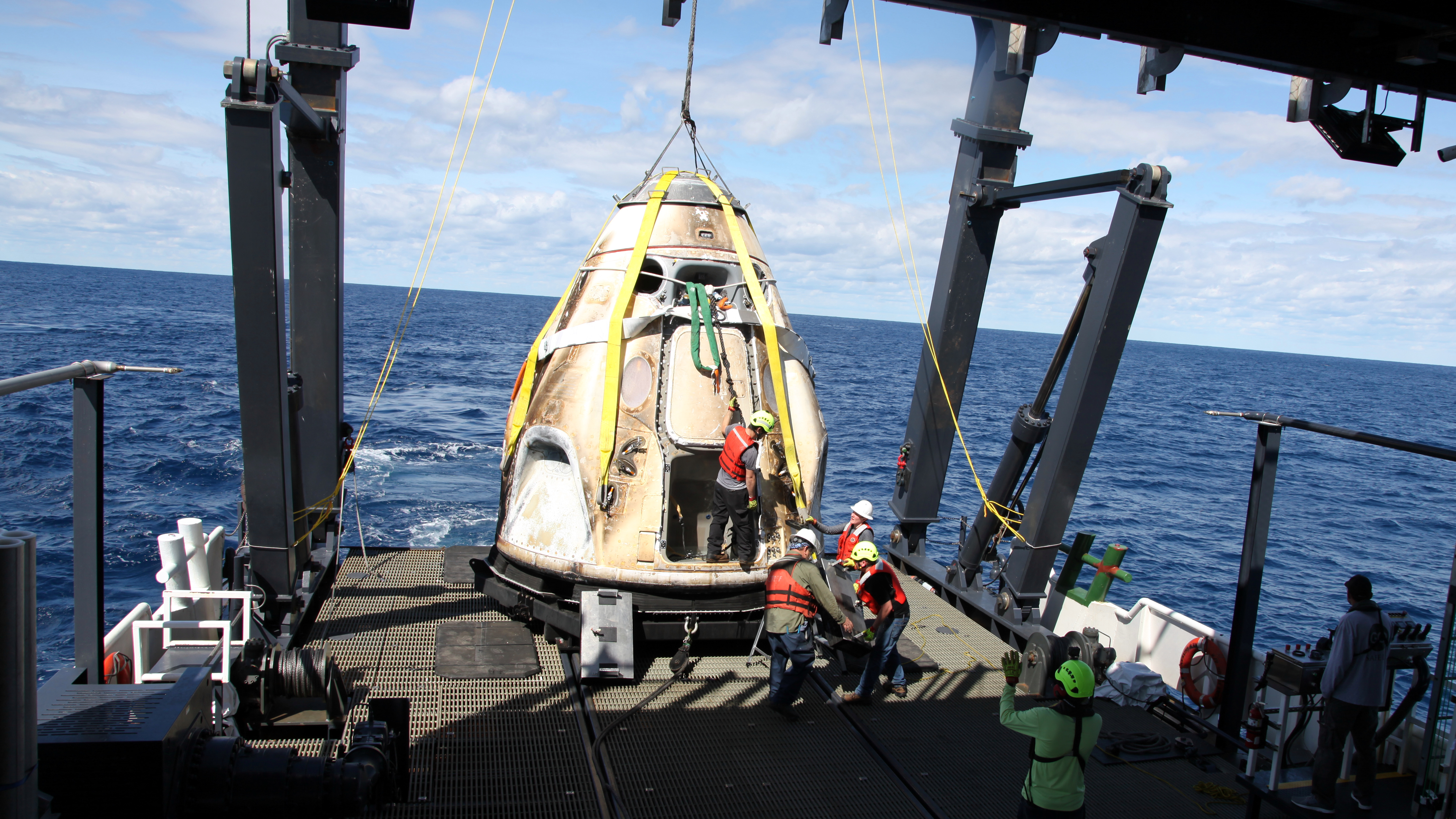 SpaceX's Crew Dragon is loaded onto the company's recovery ship, Go Searcher, in the Atlantic Ocean, about 200 miles off Florida's east coast, on March 8, after returning from the International Space Station on the Demo-1 mission. The uncrewed spacecraft docked to the orbiting laboratory on March 3, following a 2:49 a.m. EST liftoff aboard a SpaceX Falcon 9 rocket from Launch Complex 39A at NASA's Kennedy Space Center in Florida on March 2. The spacecraft undocked at 2:32 a.m., March 8, splashing down in the Atlantic Ocean, at 8:45 a.m. SpaceX's inaugural flight with NASA's Commercial Crew Program is the first flight test of a space system designed for humans built and operated by a commercial company through a public-private partnership. NASA and SpaceX will use data from Demo-1 to further prepare for Demo-2, the crewed flight test that will carry NASA astronauts Bob Behnken and Doug Hurley to the International Space Station later this year.