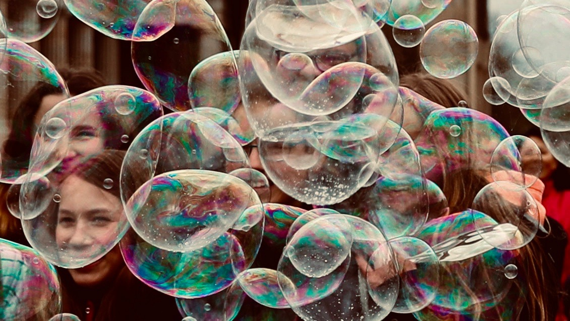 People behind bubbles.