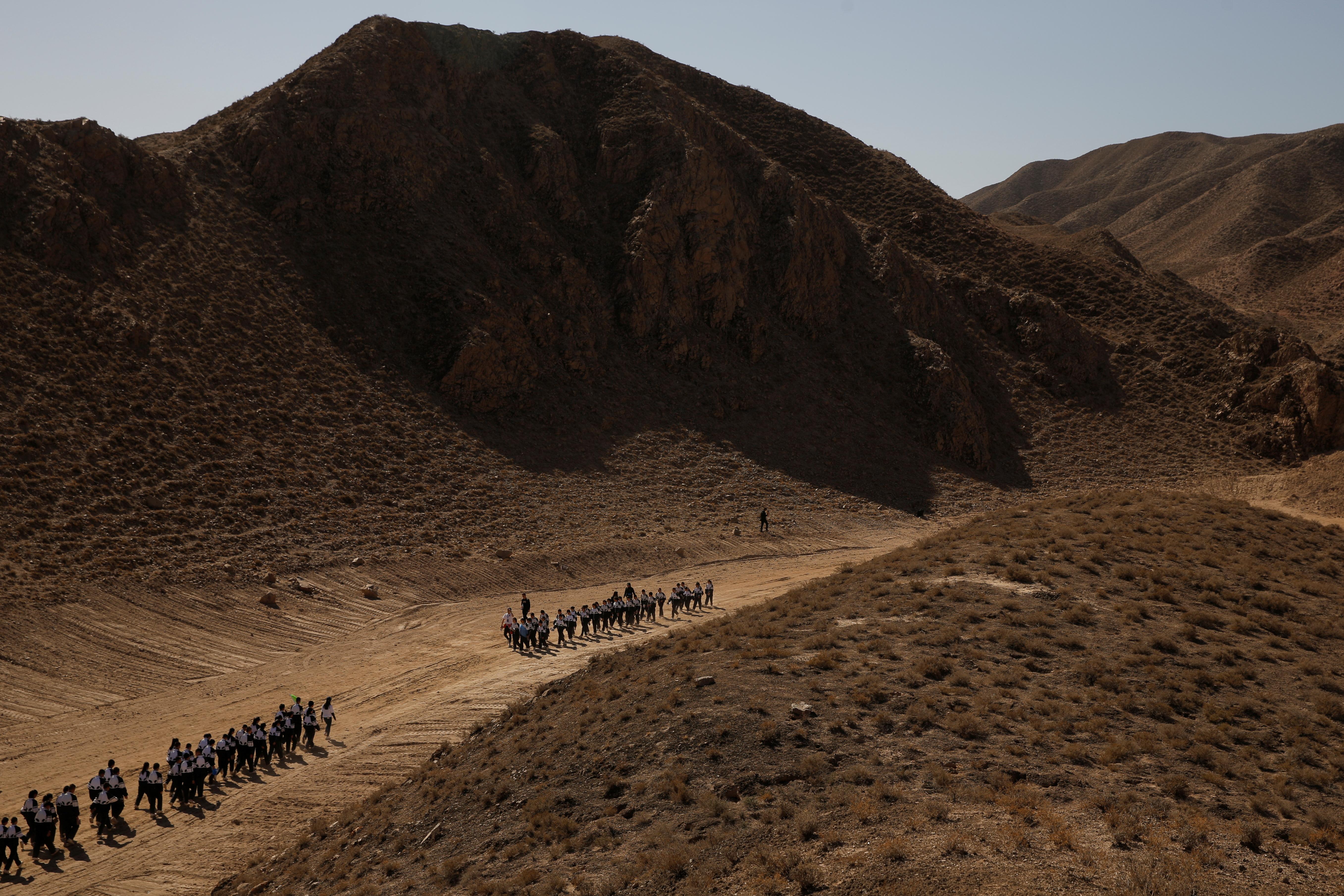Students walk through Gobi Desert