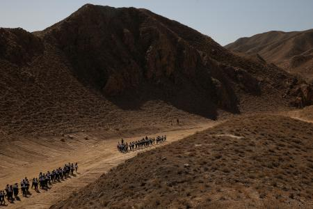 Students walk through Gobi Desert
