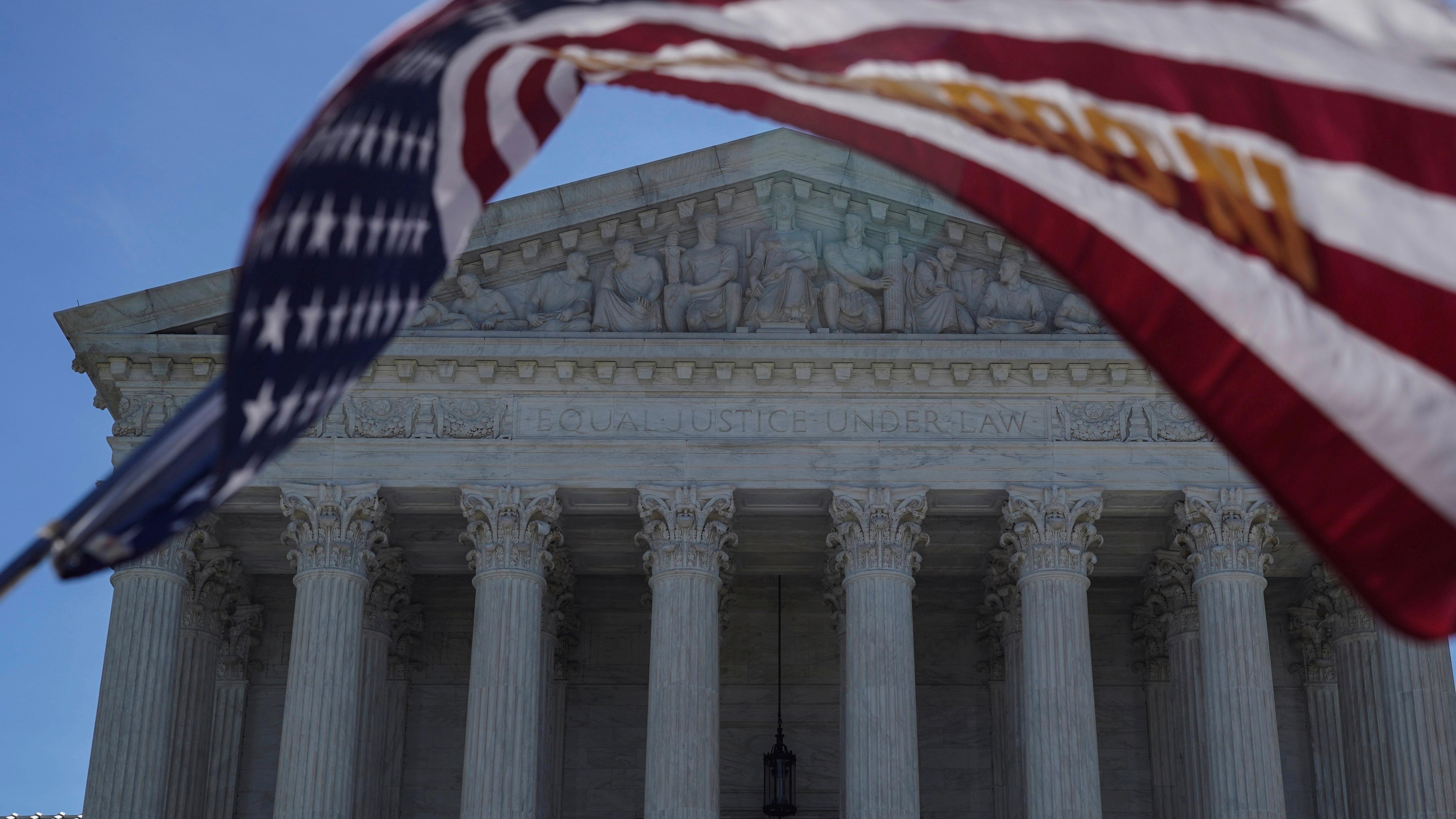 Supreme Court and US flag.