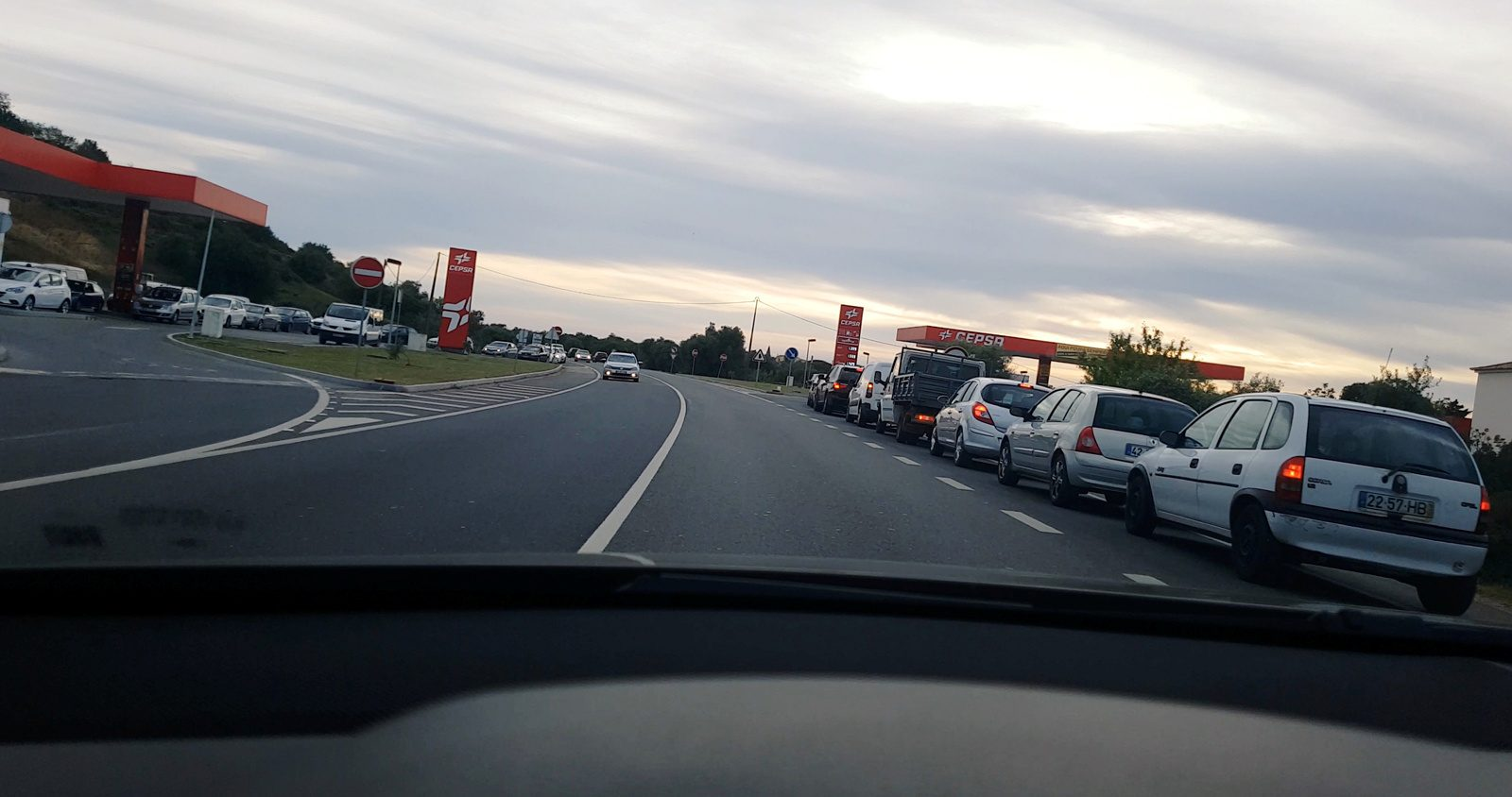 Cars and trucks line up for fuel in Albufeira, Portugal April 16, 2019 in this still image taken from social media video.